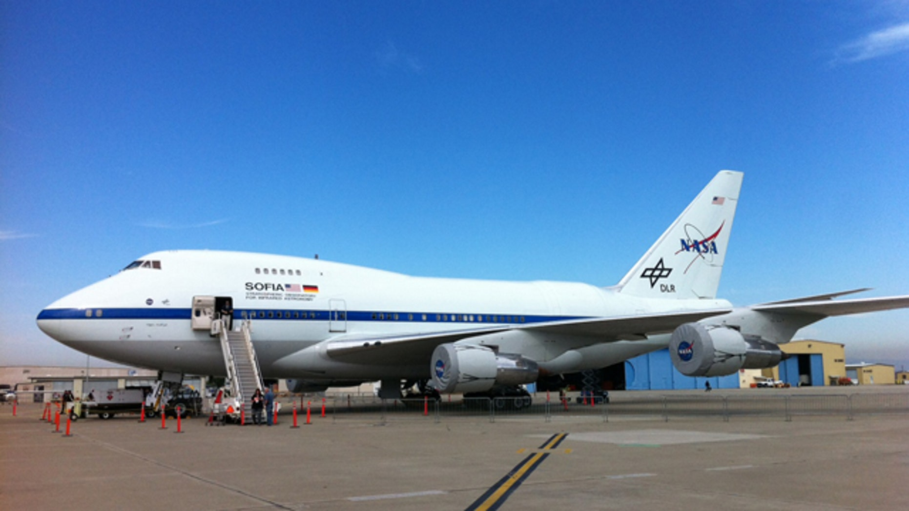 The Stratospheric Observatory for Infrared Astronomy -- a modified Boeing 747 that holds the largest airborne observatory -- sits on the tarmac awaiting its latest flight.