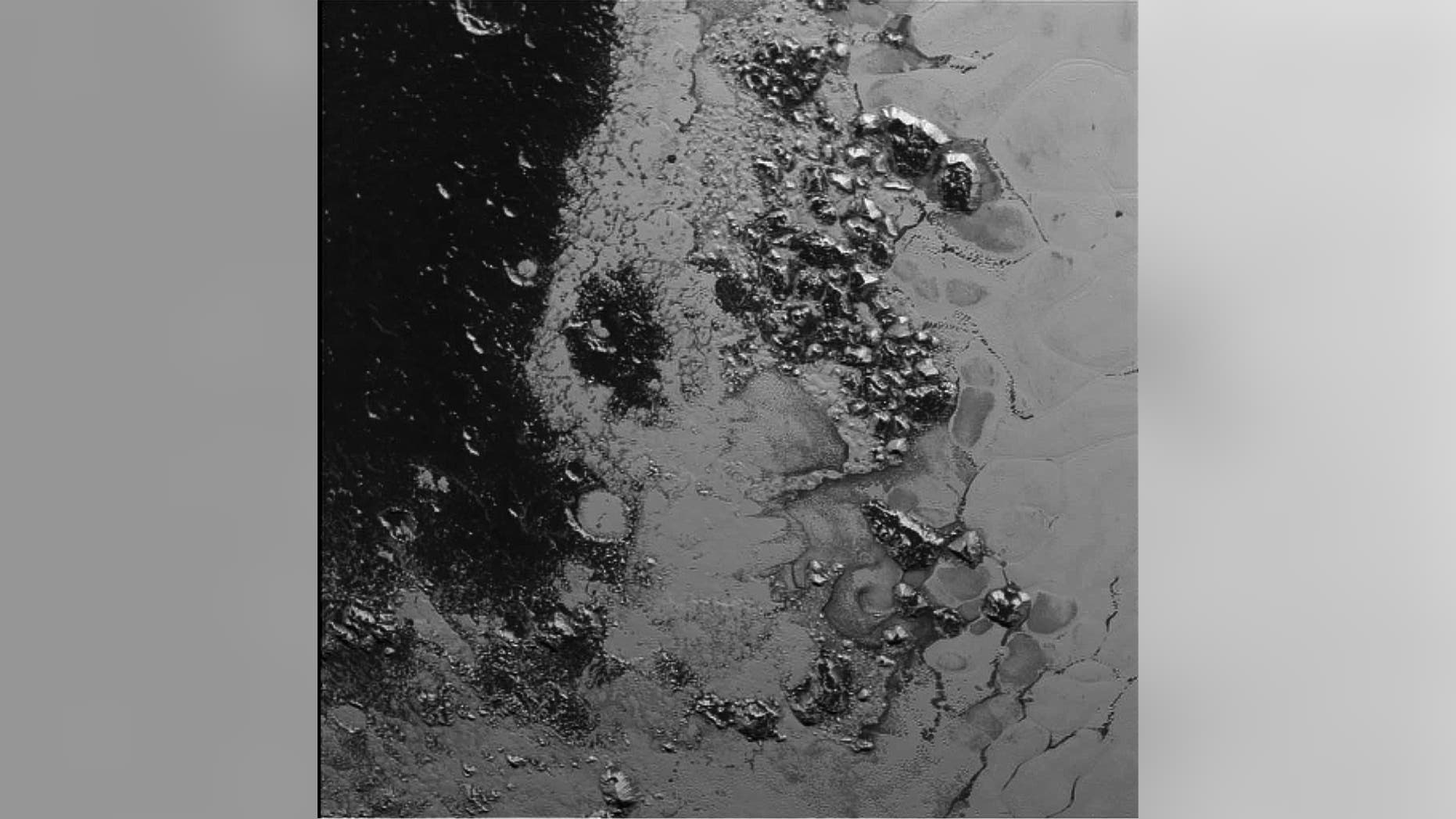 Image acquired by New Horizons' Long Range Reconnaissance Imager (LORRI) on July 14, 2015 from a distance of 48,000 miles and sent back to Earth on July 20.