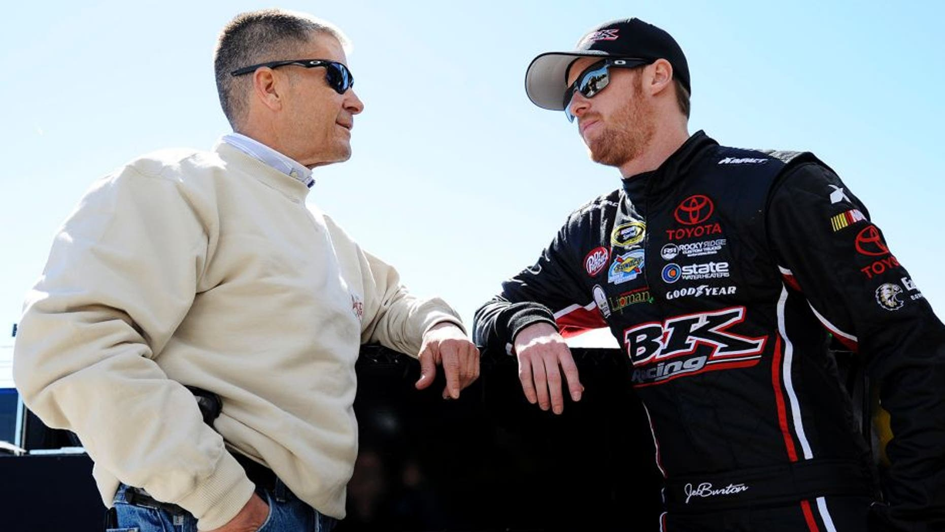 DAYTONA BEACH, FL - FEBRUARY 19: Jeb Burton, driver of the #26 LiveDeal.com Download the App Toyota, talks to his father Ward Burton in the garage area during practice for the NASCAR Sprint Cup Series 57th Annual Daytona 500 at Daytona International Speedway on February 19, 2015 in Daytona Beach, Florida. (Photo by Jared C. Tilton/Getty Images)