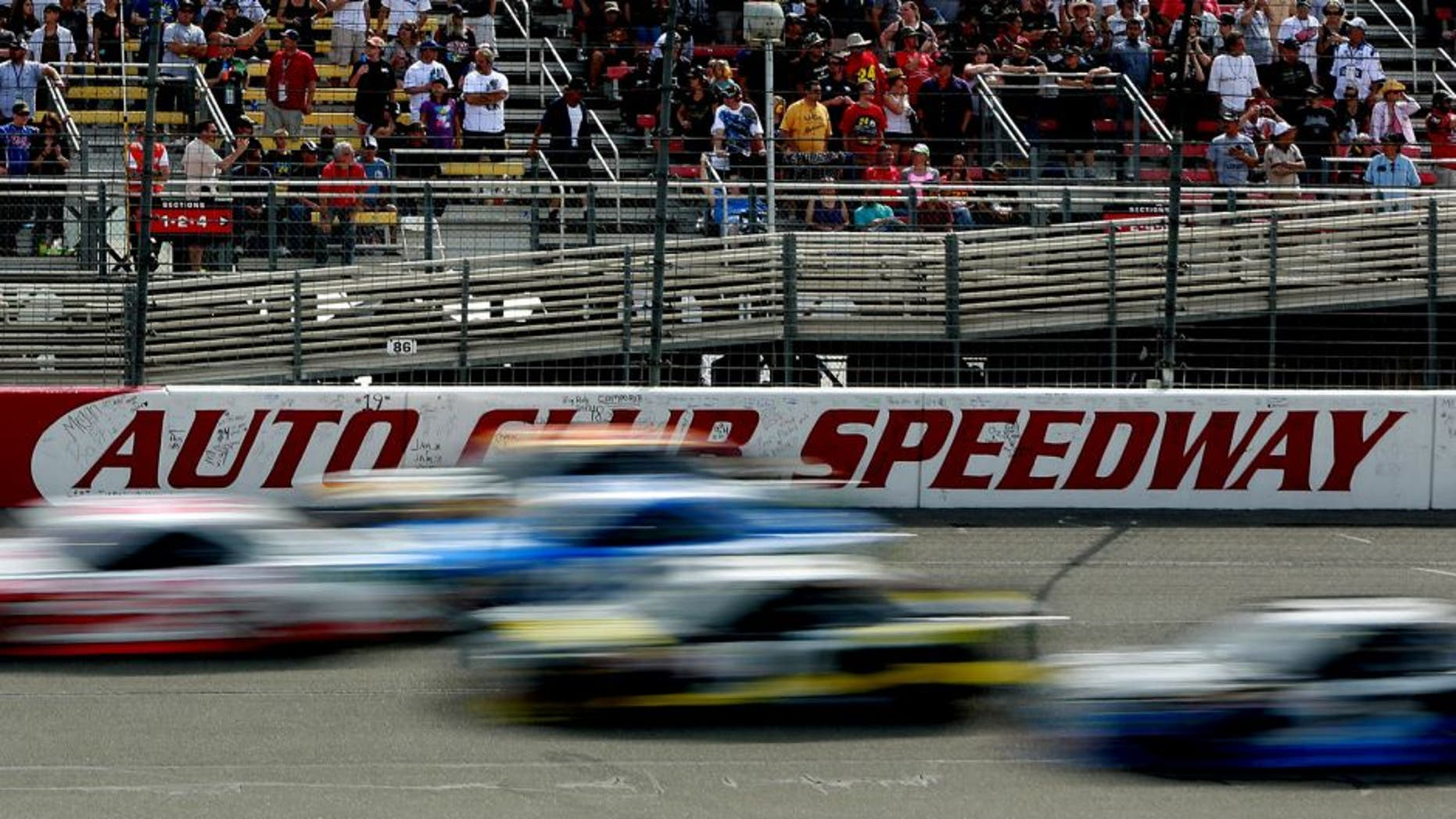 FONTANA, CA - MARCH 22: A view of cars racing during the NASCAR Sprint Cup Series Auto Club 400 at Auto Club Speedway on March 22, 2015 in Fontana, California. (Photo by Jerry Markland/Getty Images)