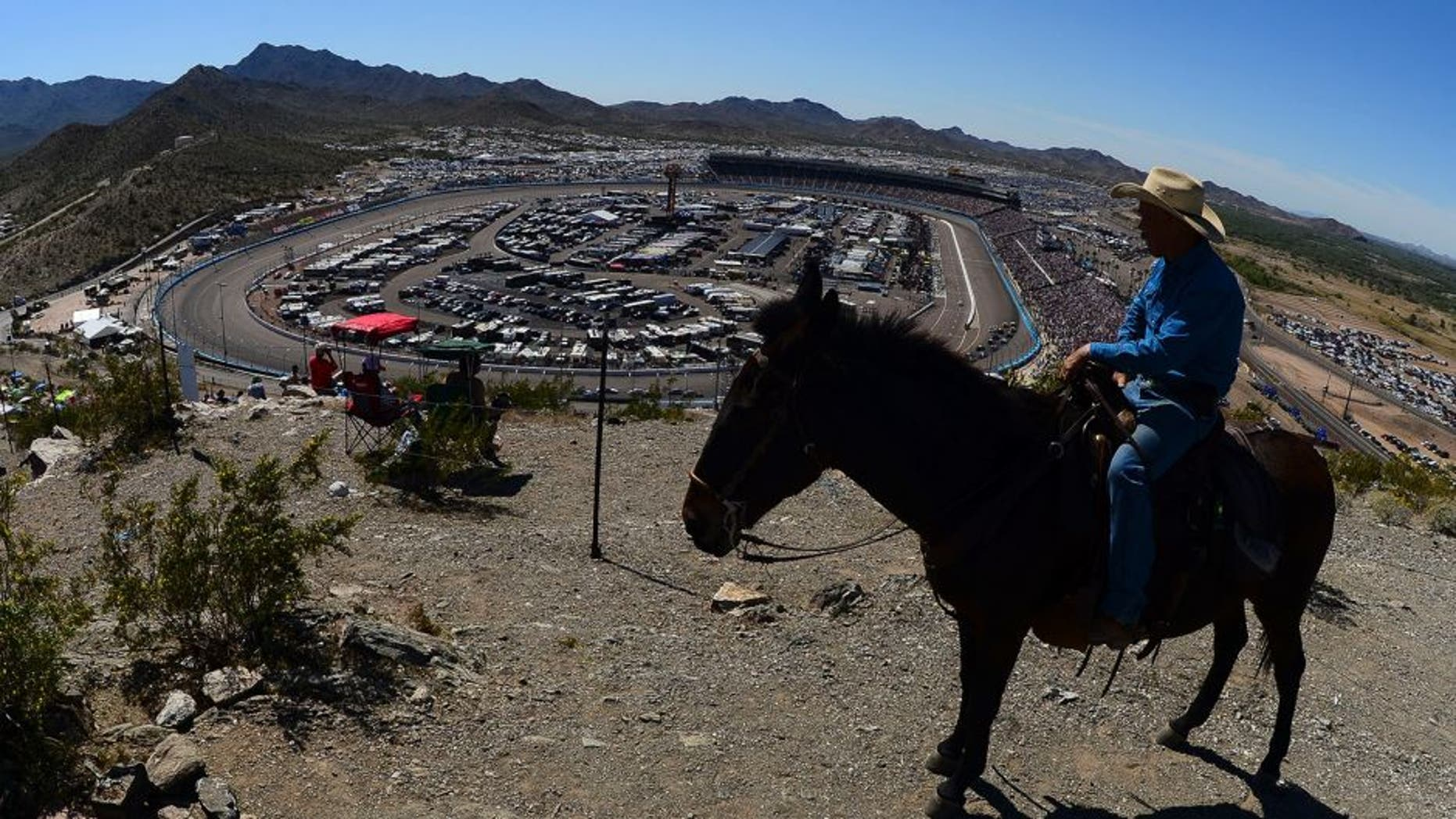 A race fan on horseback looks on during the NASCAR Sprint Cup Series CampingWorld.com 500 at Phoenix International Raceway on March 15, 2015 in Avondale, Arizona.