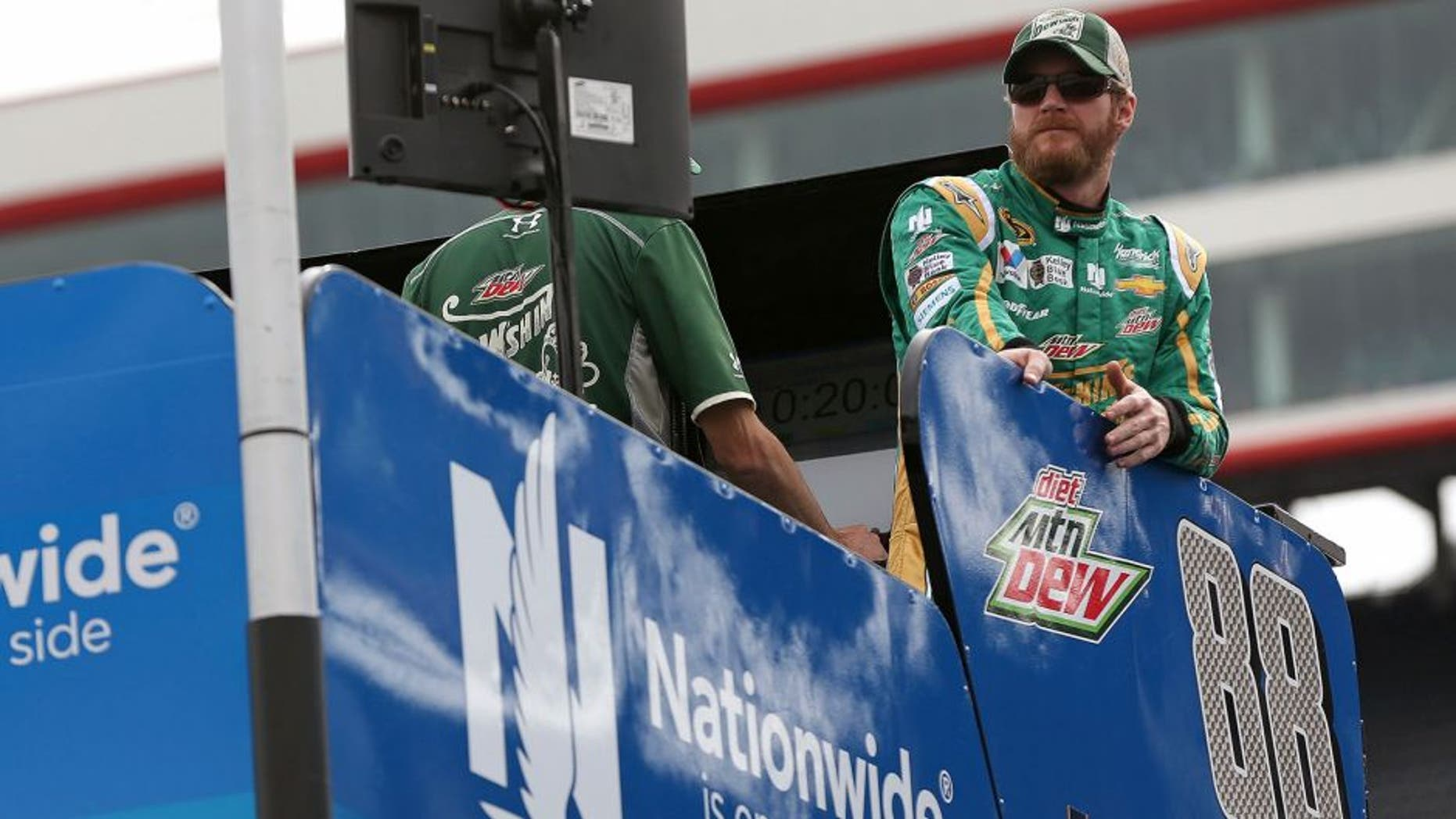 BRISTOL, TN - APRIL 17: Dale Earnhardt Jr., driver of the #88 Mountain Dew Dewshine Chevrolet, stands on top of his hauler prior to qualifying for the NASCAR Sprint Cup Series Food City 500 at Bristol Motor Speedway on April 17, 2015 in Bristol, Tennessee. (Photo by Mike Ehrmann/Getty Images)