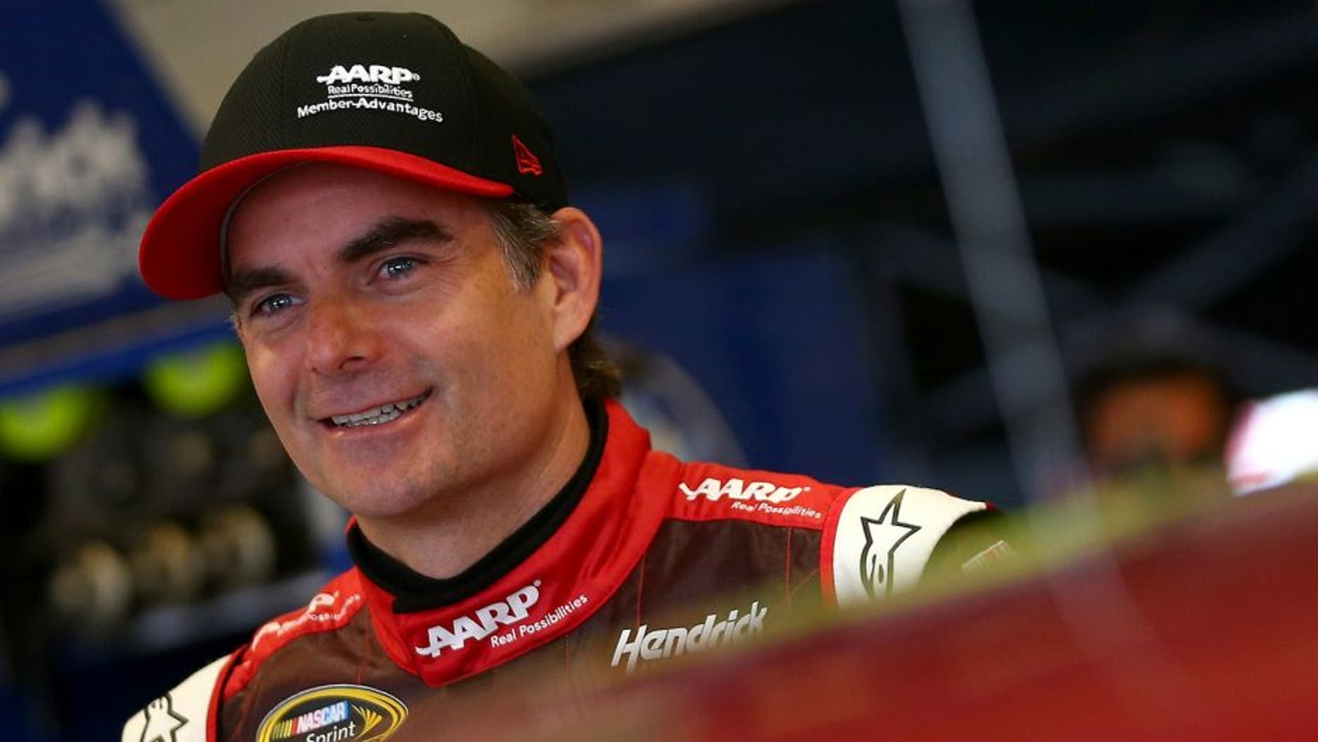 SPARTA, KY - JULY 10: Jeff Gordon, driver of the #24 AARP Member Advantages Chevrolet, looks on in the garage area during practice for the NASCAR Sprint Cup Series Quaker State 400 Presented by Advance Auto Parts at Kentucky Speedway on July 10, 2015 in Sparta, Kentucky. (Photo by Sarah Crabill/Getty Images)