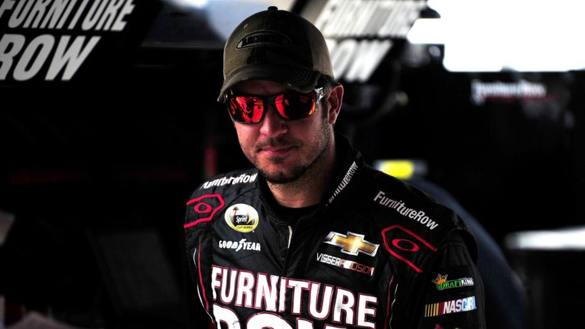 BRISTOL, TN - AUGUST 21: Martin Truex Jr., driver of the #78 Furniture Row/Visser Precision Chevrolet, stands in the garage area during practice for the NASCAR Sprint Cup Series Irwin Tools Night Race at Bristol Motor Speedway on August 21, 2015 in Bristol, Tennessee. (Photo by Jeff Curry/NASCAR via Getty Images)