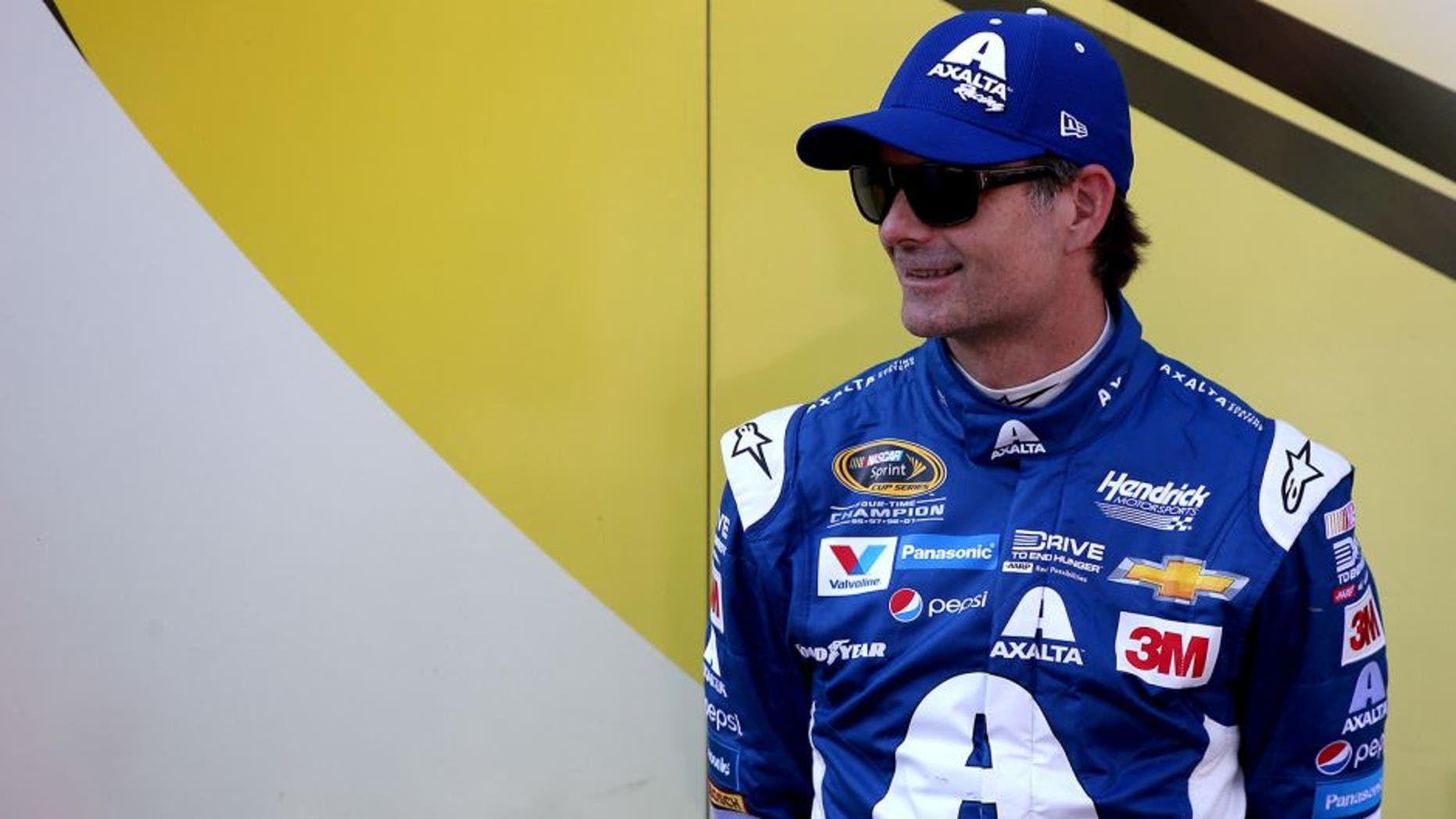 BRISTOL, TN - AUGUST 21: Jeff Gordon, driver of the #24 Axalta Chevrolet, stands in the garage area during qualifying for the NASCAR Sprint Cup Series Irwin Tools Night Race at Bristol Motor Speedway on August 21, 2015 in Bristol, Tennessee. (Photo by Sean Gardner/Getty Images)