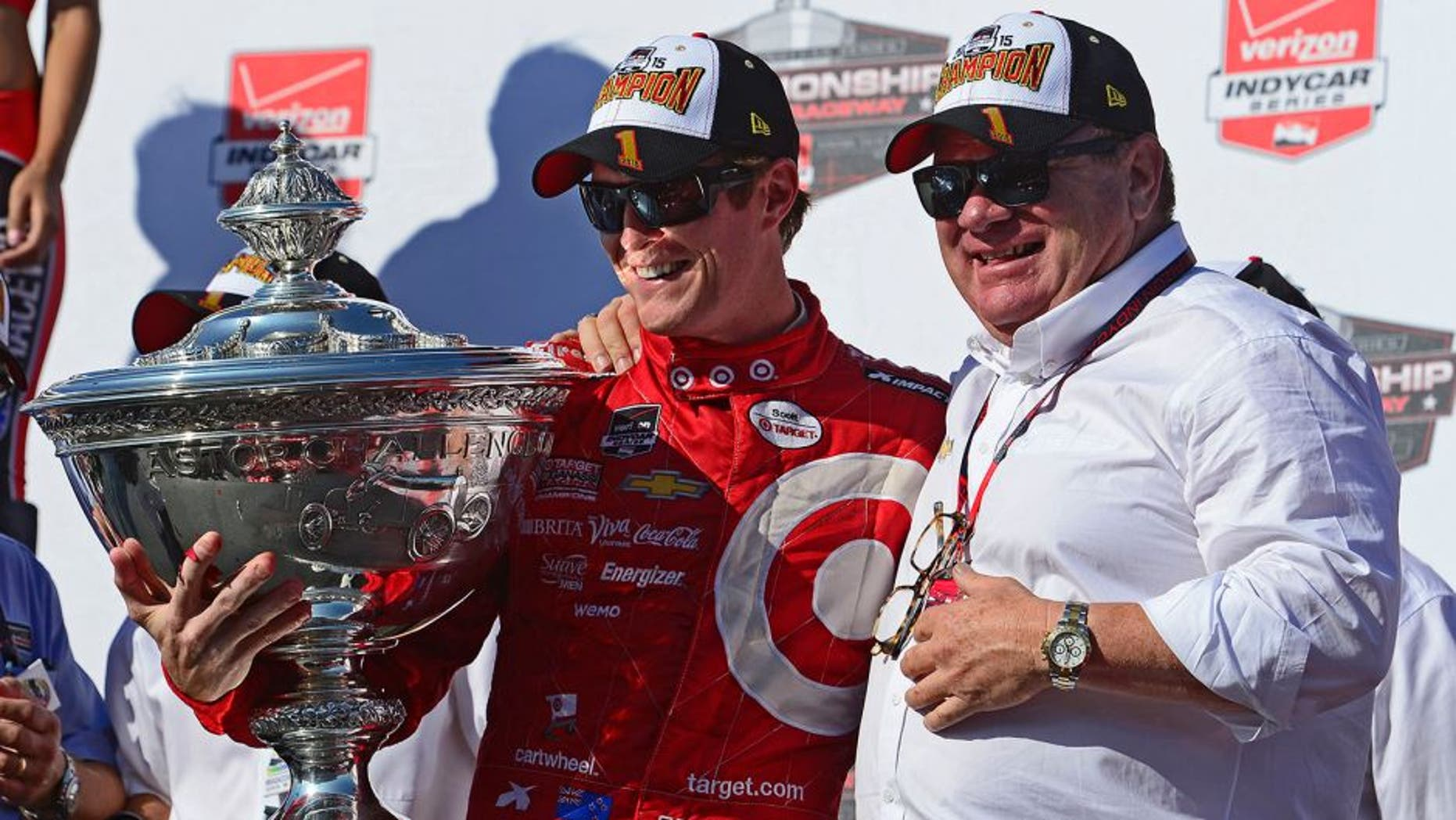 SONOMA, CA - AUGUST 30: Scott Dixon of New Zealand driver of the #9 Target Chip Ganassi Racing Chevrolet Dallara and team owner Chip Ganassi pose with the Championship Trophy presentation stage after winning the Verizon IndyCar Series GoPro Grand Prix of Sonoma at Sonoma Raceway on August 30, 2015 in Sonoma, California. (Photo by Robert Laberge/Getty Images)