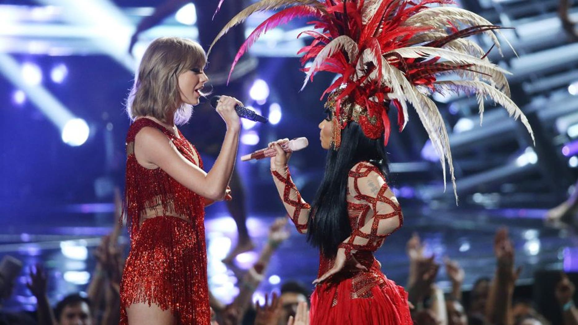 LOS ANGELES, CA - AUGUST 30: Taylor Swift (L) and Nicki Minaj perform onstage during the 2015 MTV Video Music Awards held at Microsoft Theater on August 30, 2015 in Los Angeles, California. (Photo by Michael Tran/FilmMagic)