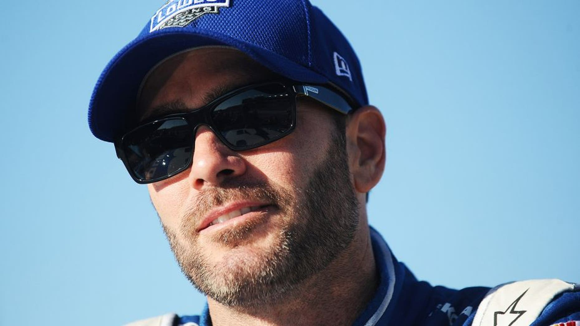 RICHMOND, VA - SEPTEMBER 11: Jimmie Johnson, driver of the #48 Lowe's Chevrolet, stands on the grid during qualifying for the NASCAR Sprint Cup Series Federated Auto Parts 400 at Richmond International Raceway on September 11, 2015 in Richmond, Virginia. (Photo by Rainier Ehrhardt/NASCAR via Getty Images)