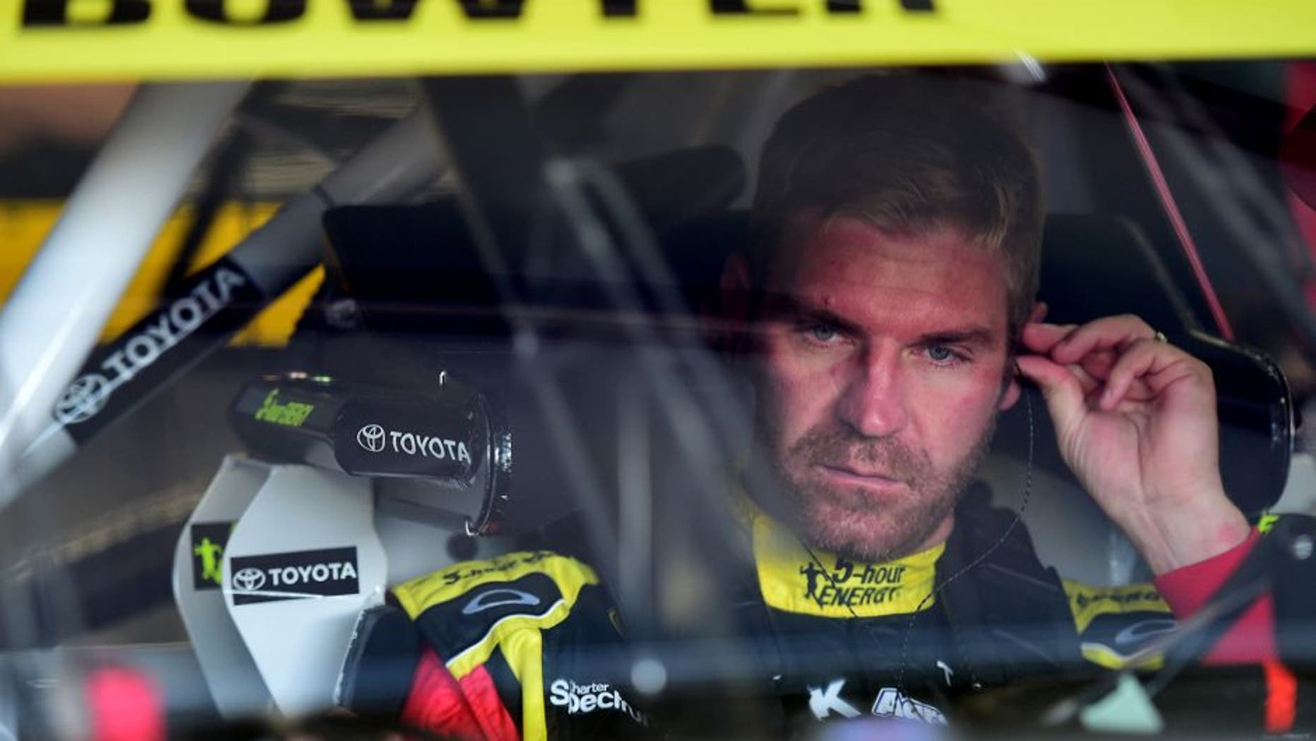 LOUDON, NH - SEPTEMBER 26: Clint Bowyer, driver of the #15 5-Hour Energy Toyota, sits in his car during practice for the NASCAR Sprint Cup Series Sylvania 300 at New Hampshire Motor Speedway on September 26, 2015 in Loudon, New Hampshire. (Photo by Jared C. Tilton/Getty Images)