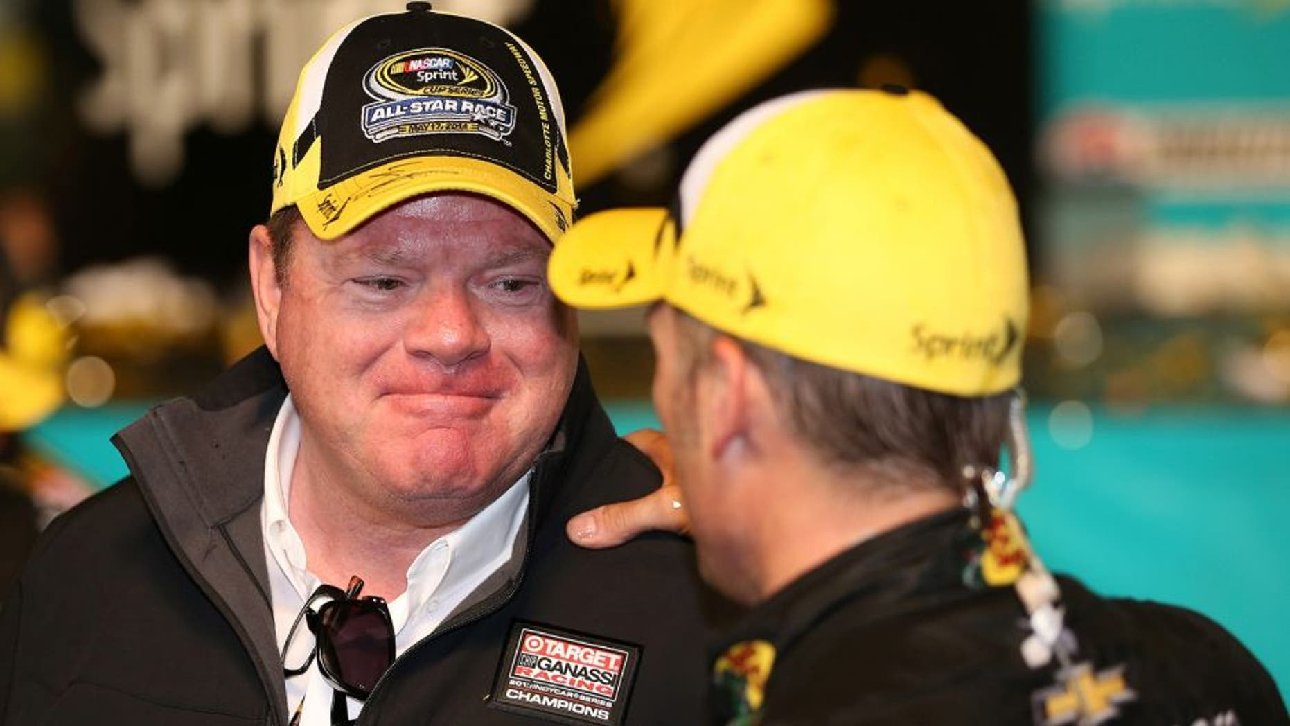 CHARLOTTE, NC - MAY 17: Chip Ganassi (L), owner of Chip Ganassi Racing, talks so Jamie McMurray, driver of the #1 Bass Pro Chevrolet, in victory lane after the NASCAR Sprint Cup Series Sprint All-Star Race at Charlotte Motor Speedway on May 17, 2014 in Charlotte, North Carolina. (Photo by Chris Graythen/Getty Images)