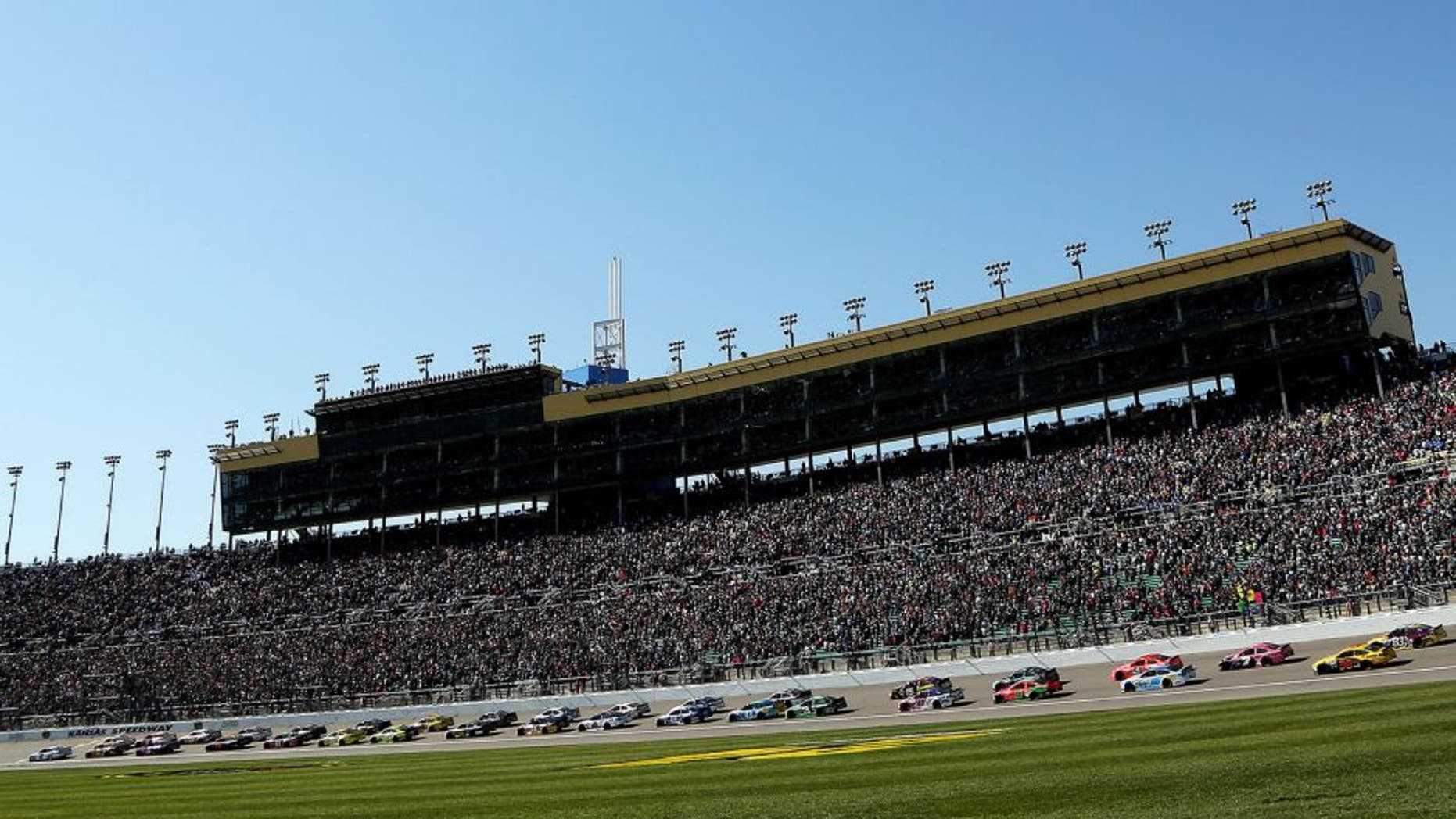 KANSAS CITY, KS - OCTOBER 18: General view as Brad Keselowski, driver of the #2 Miller Lite Ford, leads the field past the green flag to start the NASCAR Sprint Cup Series Hollywood Casino 400 at Kansas Speedway on October 18, 2015 in Kansas City, Kansas. (Photo by Jerry Markland/Getty Images)