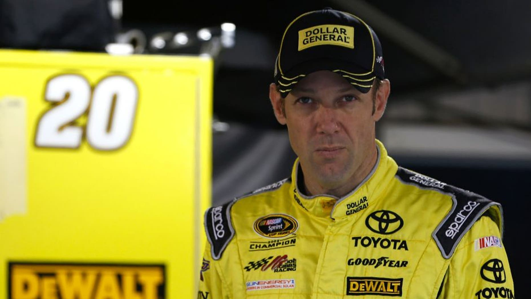 MARTINSVILLE, VA - OCTOBER 31: Matt Kenseth, driver of the #20 Dollar General Toyota, stands in the garage area during practice for the NASCAR Sprint Cup Series Goody's Headache Relief Shot 500 at Martinsville Speedway on October 31, 2015 in Martinsville, Virginia. (Photo by Jeff Zelevansky/Getty Images)