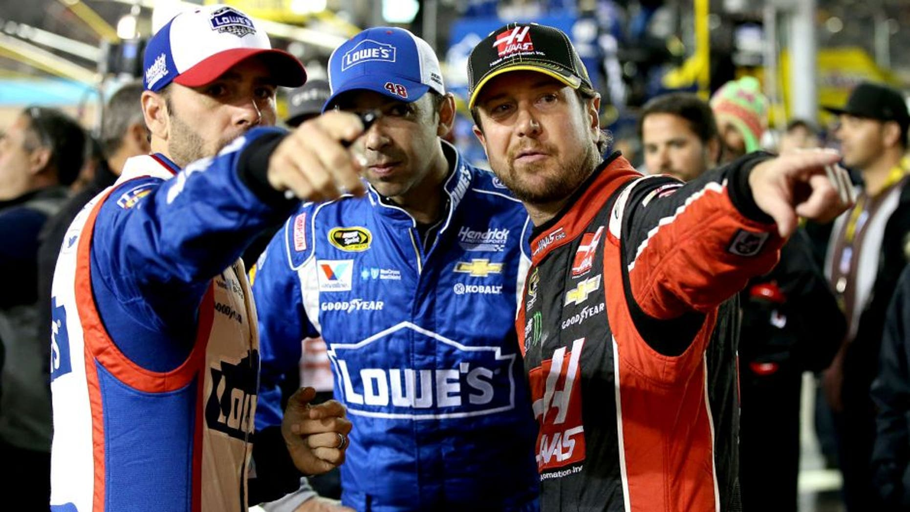 AVONDALE, AZ - NOVEMBER 15: (L-R) Jimmie Johnson, driver of the #48 Lowe's Patriotic Chevrolet, crew chief Chad Knaus and Kurt Busch, driver of the #41 Haas Automation Chevrolet, talk on pit road before the NASCAR Sprint Cup Series Quicken Loans Race for Heroes 500 at Phoenix International Raceway on November 15, 2015 in Avondale, Arizona. (Photo by Sean Gardner/Getty Images)