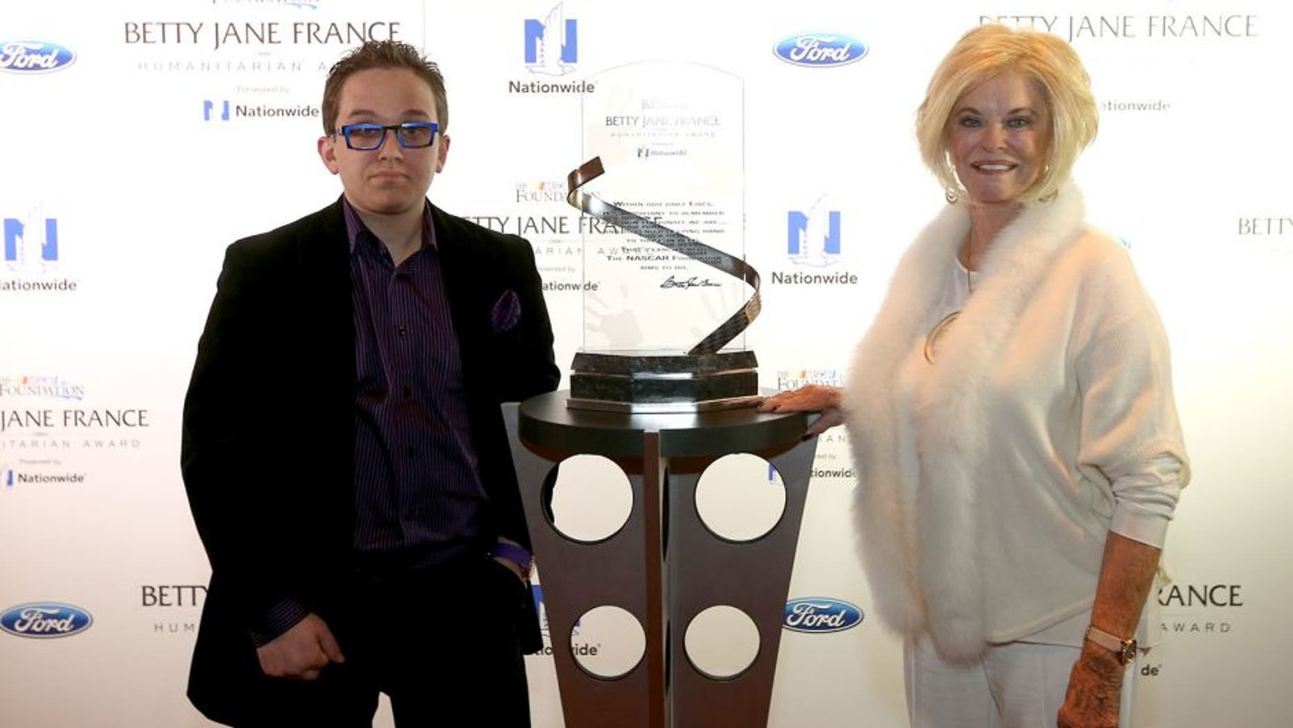 LAS VEGAS, NV - DECEMBER 02: Betty Jane France poses with Jeff Hanson of Overland Park, Kansas, who represents the Children's Tumor Foundation, during the Betty Jane France Humanitarian Award Reception inside Wynn Las Vegas during NASCAR Champion's Week on December 2, 2015 in Las Vegas, Nevada. (Photo by Chris Graythen/NASCAR via Getty Images)