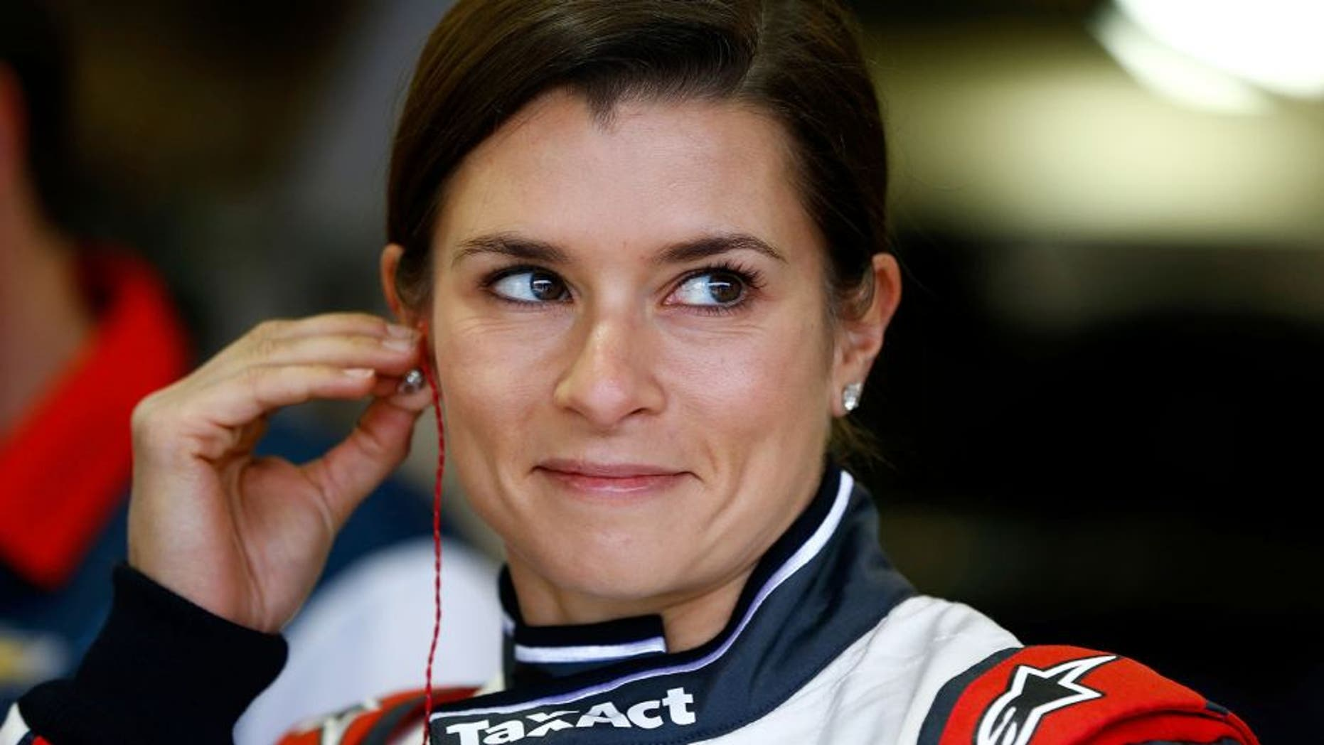 FONTANA, CA - MARCH 19: Danica Patrick, driver of the #10 TaxACT Chevrolet, adjusts her equipment in the garage area during practice for the NASCAR Sprint Cup Series Auto Club 400 at Auto Club Speedway on March 19, 2016 in Fontana, California. (Photo by Jonathan Ferrey/Getty Images)