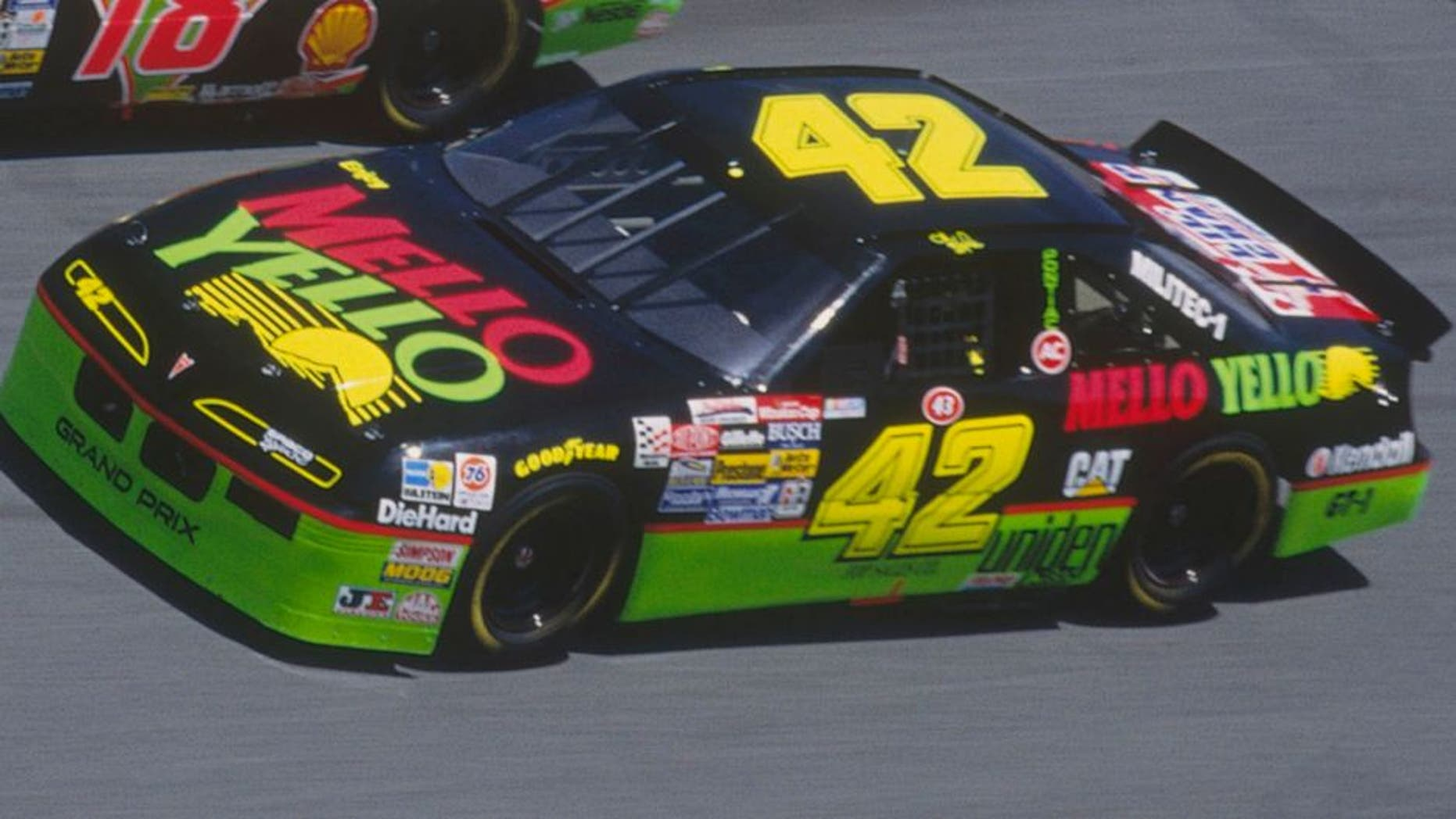 DAYTONA BEACH, FL - FEBRUARY 14: Dale Jarrett drives his Interstate Batteries #18 car down a turn against Kyle Petty in his Mello Yello #42 car during the Daytona 500 at the Daytona Speedway on February 14, 1993 in Daytona Beach, Florida. (Photo by Focus on Sport/Getty Images)