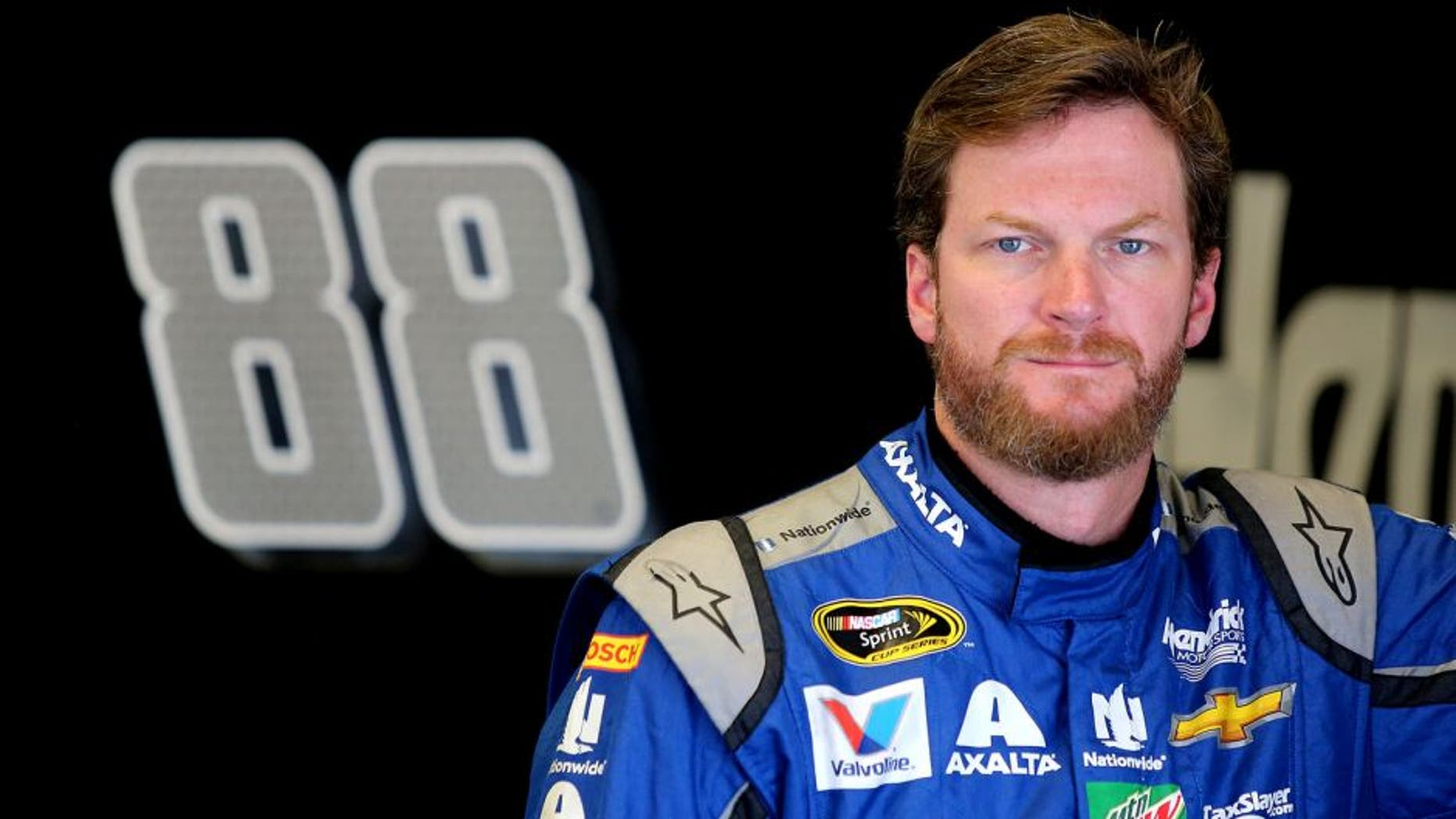 DAYTONA BEACH, FL - JUNE 30: Dale Earnhardt Jr., driver of the #88 Nationwide Chevrolet, stands in the garage area during practice for the NASCAR Sprint Cup Series Coke Zero 400 at Daytona International Speedway on June 30, 2016 in Daytona Beach, Florida. (Photo by Jerry Markland/Getty Images)