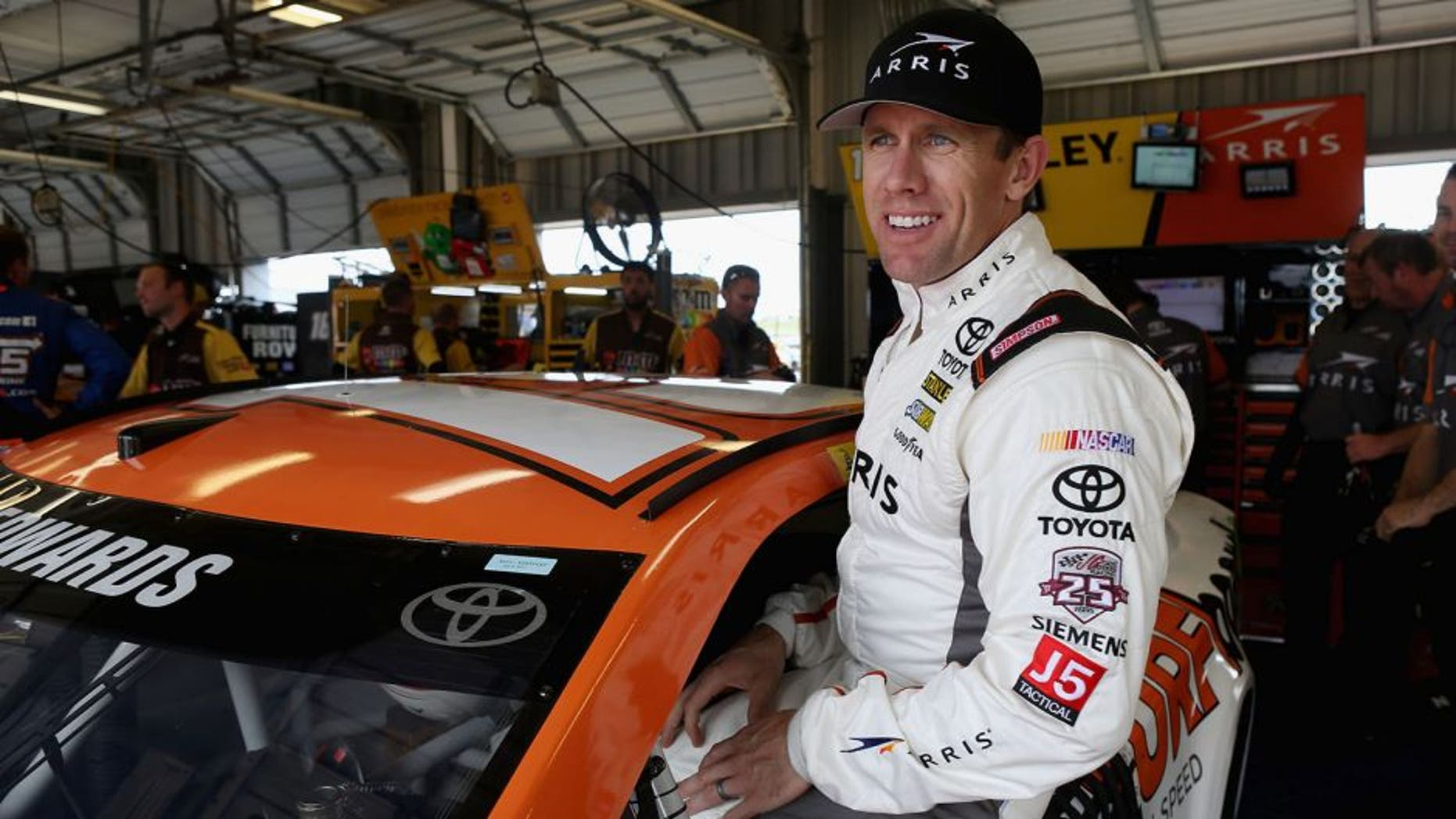 SPARTA, KY - JULY 07: Carl Edwards, driver of the #19 ARRIS Surfboard Toyota, climbs into his car during practice for the NASCAR Sprint Cup Series Quaker State 400 at Kentucky Speedway on July 7, 2016 in Sparta, Kentucky. (Photo by Dylan Buell/Getty Images)