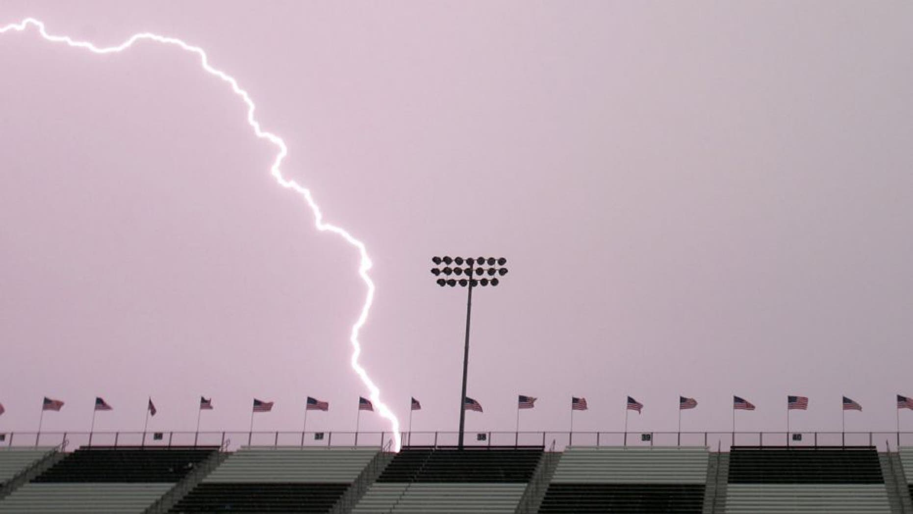 MADISON, IL - JULY 29: Lightning hits behind the front stretch grandstands during a thunderstorm before the start of the NASCAR Busch Series Busch Silver Celebration 250 presented by Shop 'n Save on July 29, 2006 at the Gateway International Raceway in Madison, Illinois. (Photo by Robert Laberge/Getty Images for NASCAR)