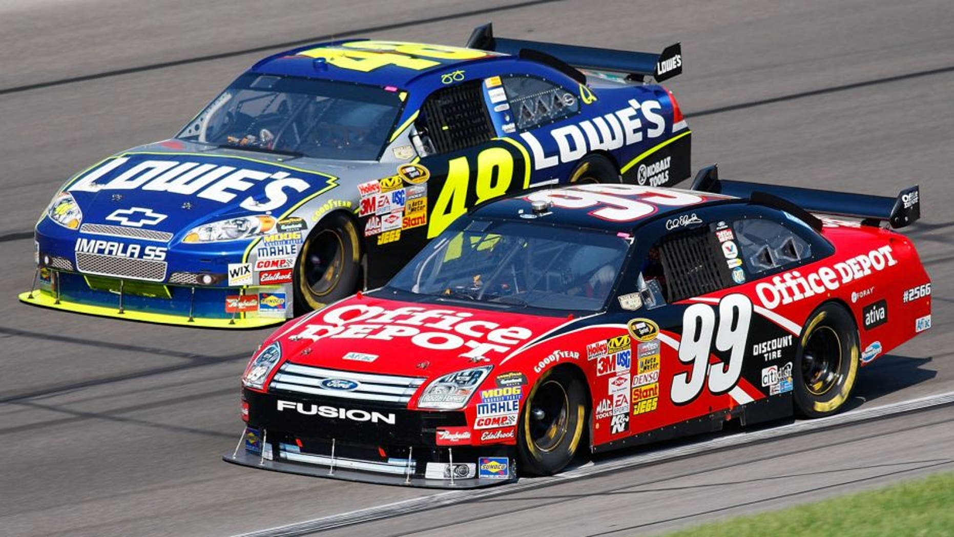 KANSAS CITY, KS - SEPTEMBER 28: Carl Edwards, driver of the #99 Office Depot Ford, and Jimmie Johnson, driver of the #48 Lowe's Chevrolet, drive during the NASCAR Sprint Cup Series Camping World RV 400 at Kansas Speedway on September 28, 2008 in Kansas City, Kansas. (Photo by John Harrelson/Getty Images for NASCAR)