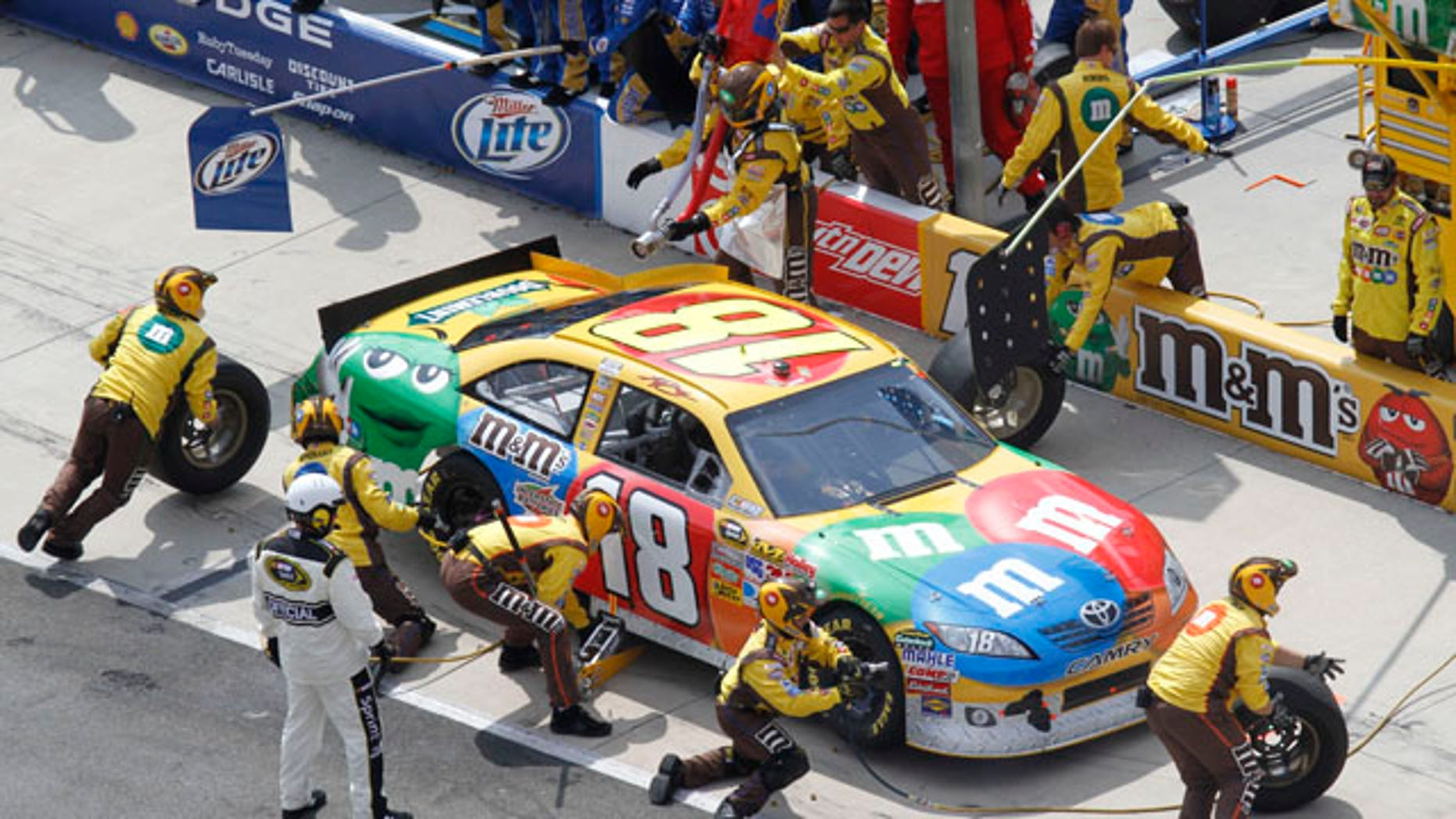 March 20, 2011: Kyle Busch (18) makes a pit stop during the NASCAR Sprint Cup Series auto race at Bristol Motor Speedway in Bristol, Tenn.