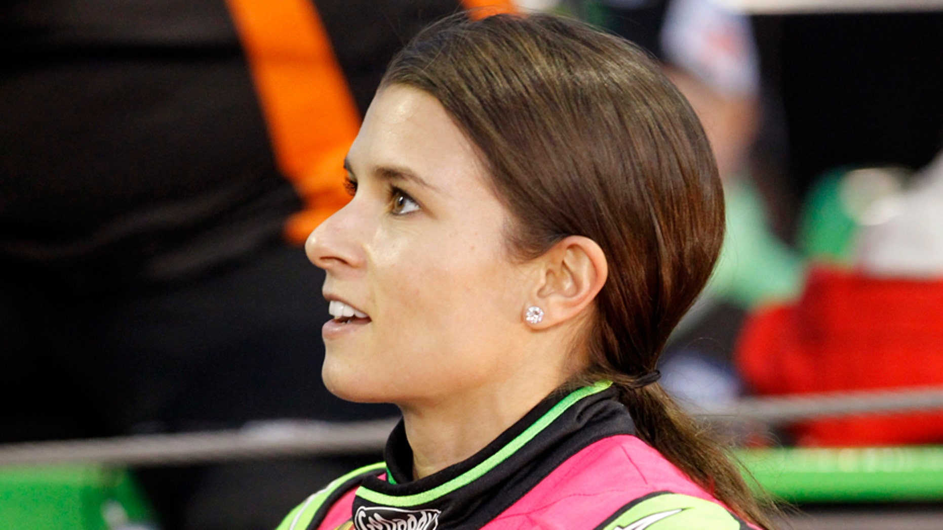 Danica Patrick talks to a crew member before qualifying for Saturday's NASCAR Bank of America Sprint Cup series auto race at Charlotte Motor Speedway in Concord, N.C., Thursday, Oct. 9, 2014. (AP Photo/Terry Renna)