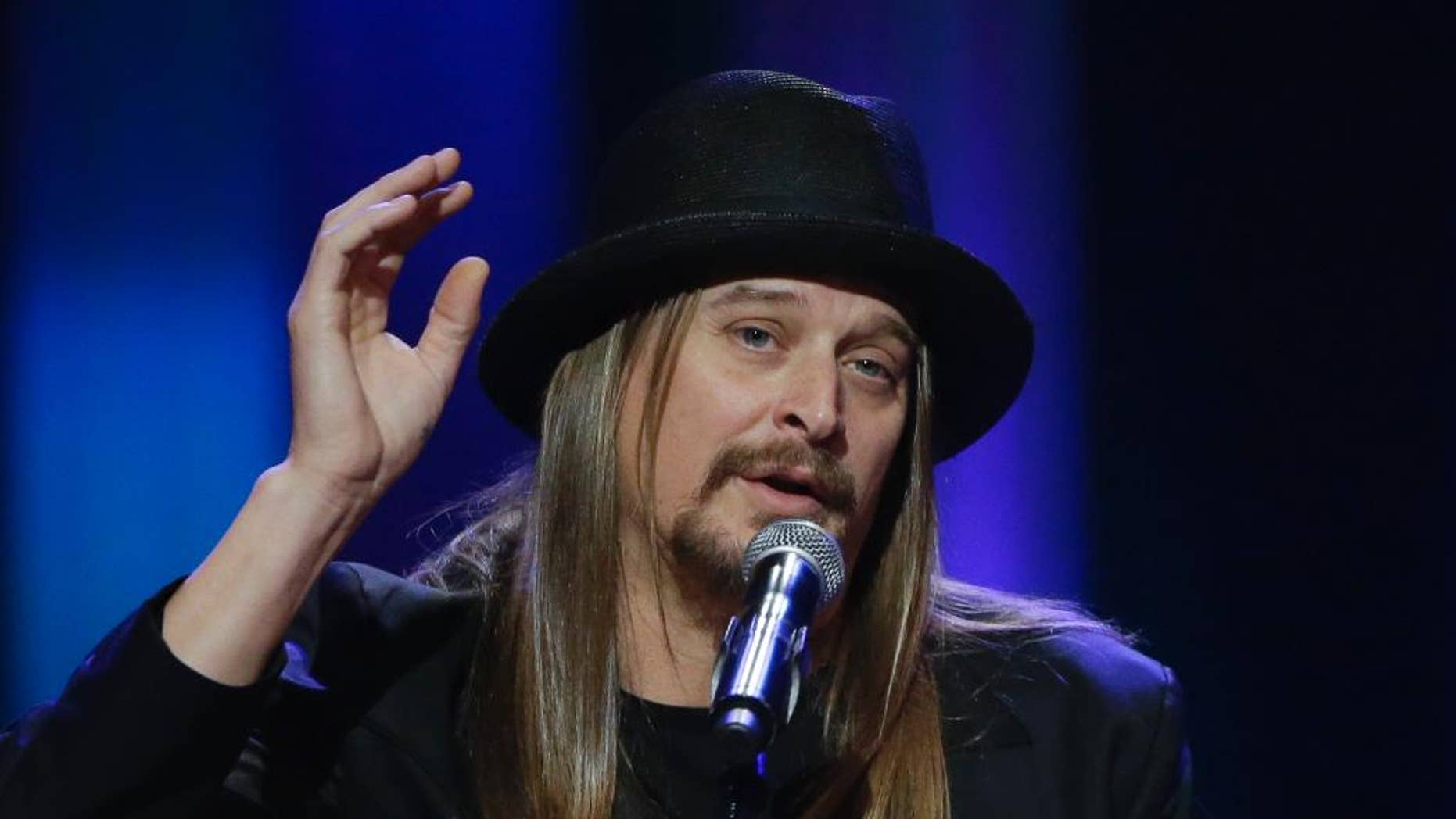 """FILE - This May 2, 2013, file photo shows Kid Rock speaking during the funeral for country music star George Jones at the Grand Ole Opry House in Nashville, Tenn. Kid Rock will perform a pre-race concert at the Daytona 500 in February. Daytona International Speedway said Friday, Dec. 19, 2014, he will play several hits as well as new single """"First Kiss."""" (AP Photo/Mark Humphrey, Pool)"""