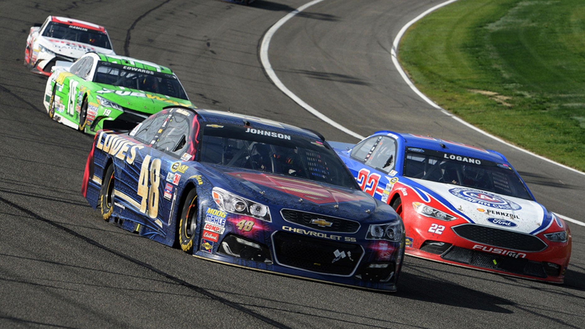 Jimmie Johnson (48) and Joey Logano (22) race for the lead during the late laps of the NASCAR 400 mile auto race Sunday, March 20, 2016, at Auto Club Speedway in Fontana, Calif. (AP Photo/Will Lester)