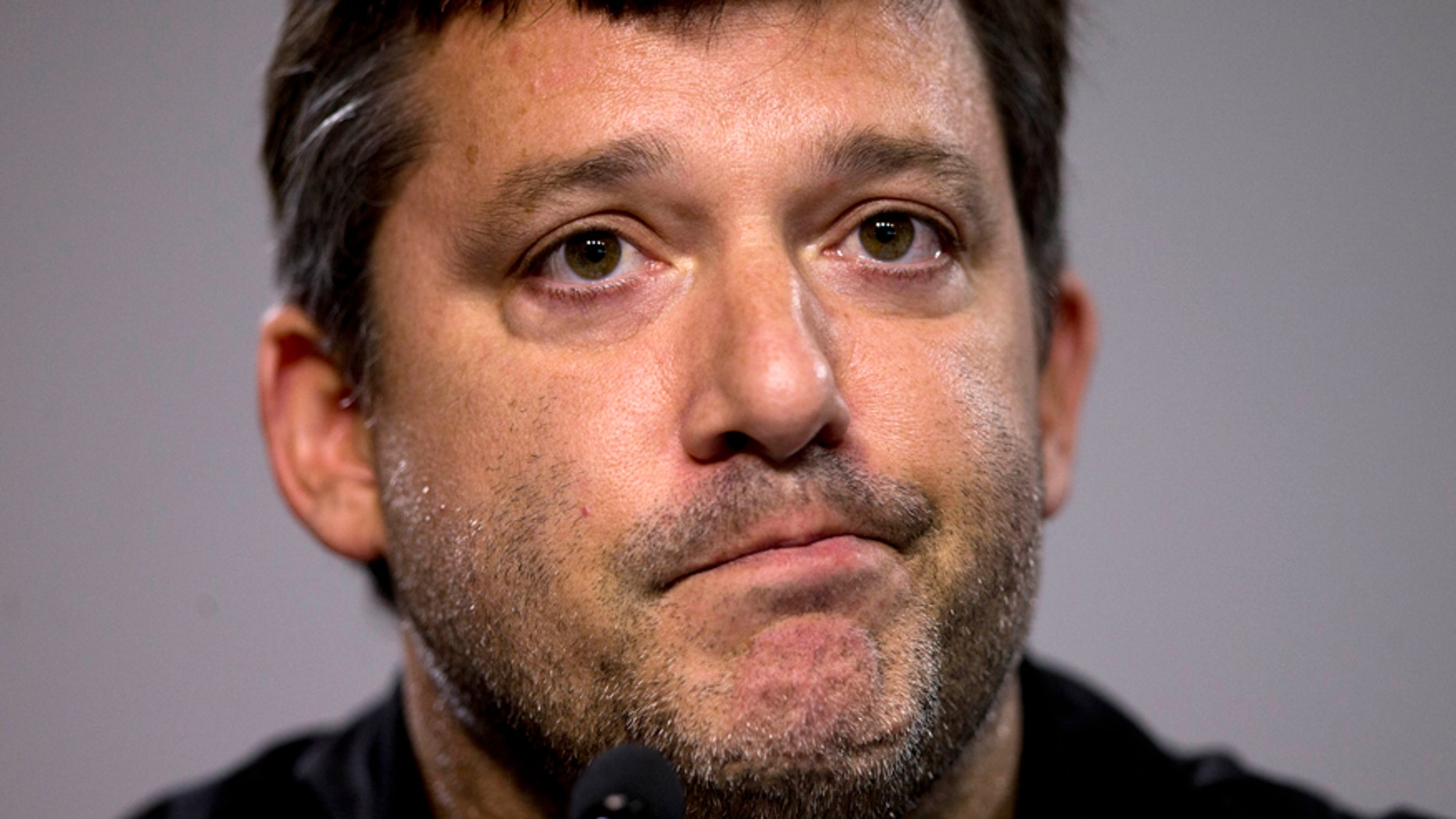 FILE - In this Aug. 29, 2014, file photo, NASCAR auto racing driver Tony Stewart reads a statement during a news conference at Atlanta Motor Speedway in Hampton, Ga. Stewart is scheduled to race Sunday at Watkins Glen International Raceway for the first time since 2012. He missed the 2013 race with a broken leg, then skipped the race last season following the accident in which his sprint car struck and killed Kevin Ward Jr. the night before the race. AP Photo/John Bazemore, File)