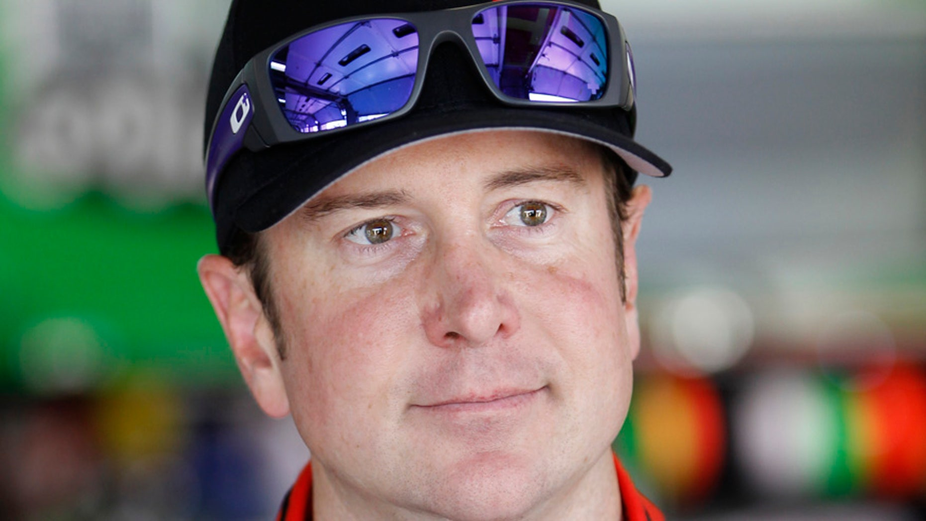 FILE - This is a May 22, 2014, file photo showing Kurt Busch waiting by his car before practice for the NASCAR Sprint Cup series Coca-Cola 600 auto race at Charlotte Motor Speedway in Concord, N.C.  Police in Delaware have interviewed NASCAR driver Kurt Busch and are continuing to investigate allegations by his ex-girlfriend that he assaulted her during the September race at Dover International Speedway. Busch, 36, and his attorneys met with investigators Tuesday, Nov. 18, 2014, Dover police spokesman Cpl. Mark Hoffman said. (AP Photo/Terry Renna, File)