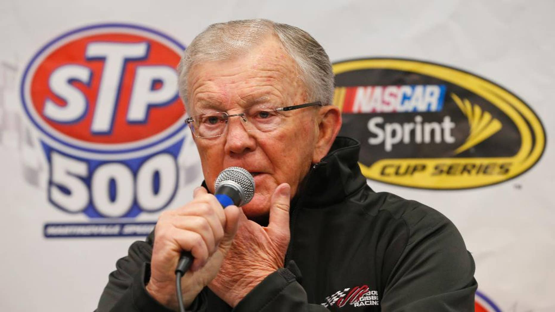 "Nascar team owner Joe Gibbs, addresses the media about the condition of his son J.D. Gibbs in the media center prior to the start of the NASCAR Sprint Cup race at the Martinsville Speedway in Martinsville, Va., Sunday, March 29, 2015. Joe Gibbs Racing President J.D. Gibbs is undergoing treatment for ""symptoms impacting areas of brain function,"" which likely stem from a head injury suffered earlier in life. (AP Photo/Steve Helber)"