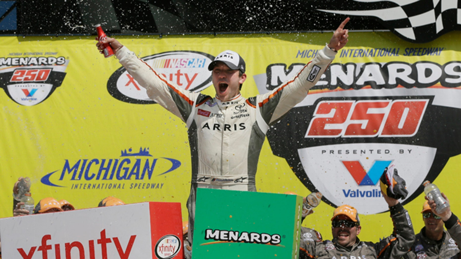 Daniel Suarez yells after winning the NASCAR Xfinity series auto race at Michigan International Speedway, Saturday, June 11, 2016 in Brooklyn, Mich. The was the first win for Suarez. (AP Photo/Carlos Osorio)