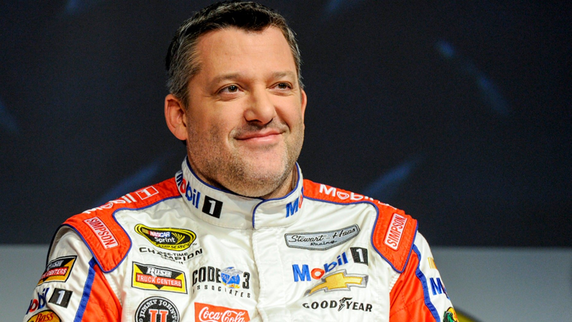 FILE - In this Thursay, Jan. 21, 2016, file photo, Stewart Haas Racing co-owner and driver Tony Stewart talks to members of the media during the NASCAR Charlotte Motor Speedway Media Tour in Charlotte, N.C. The three-time NASCAR champion has been hospitalized with a back injury after a non-racing accident on Sunday and Stewart-Haas Racing is unsure of the extent of his injuries, a team spokesman told The Associated Press, Tuesday, Feb. 2, 2016. (AP Photo/Mike McCarn, File)