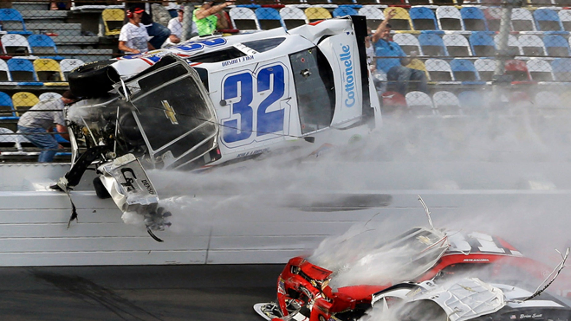 Feb. 23, 2013: Kyle Larson (32) goes airborne and into the catch fence during a multi-car crash involving Justin Allgaier (31), Brian Scott (2) and others during the final lap of the NASCAR Nationwide Series auto race at Daytona International Speedway in Daytona Beach, Fla.