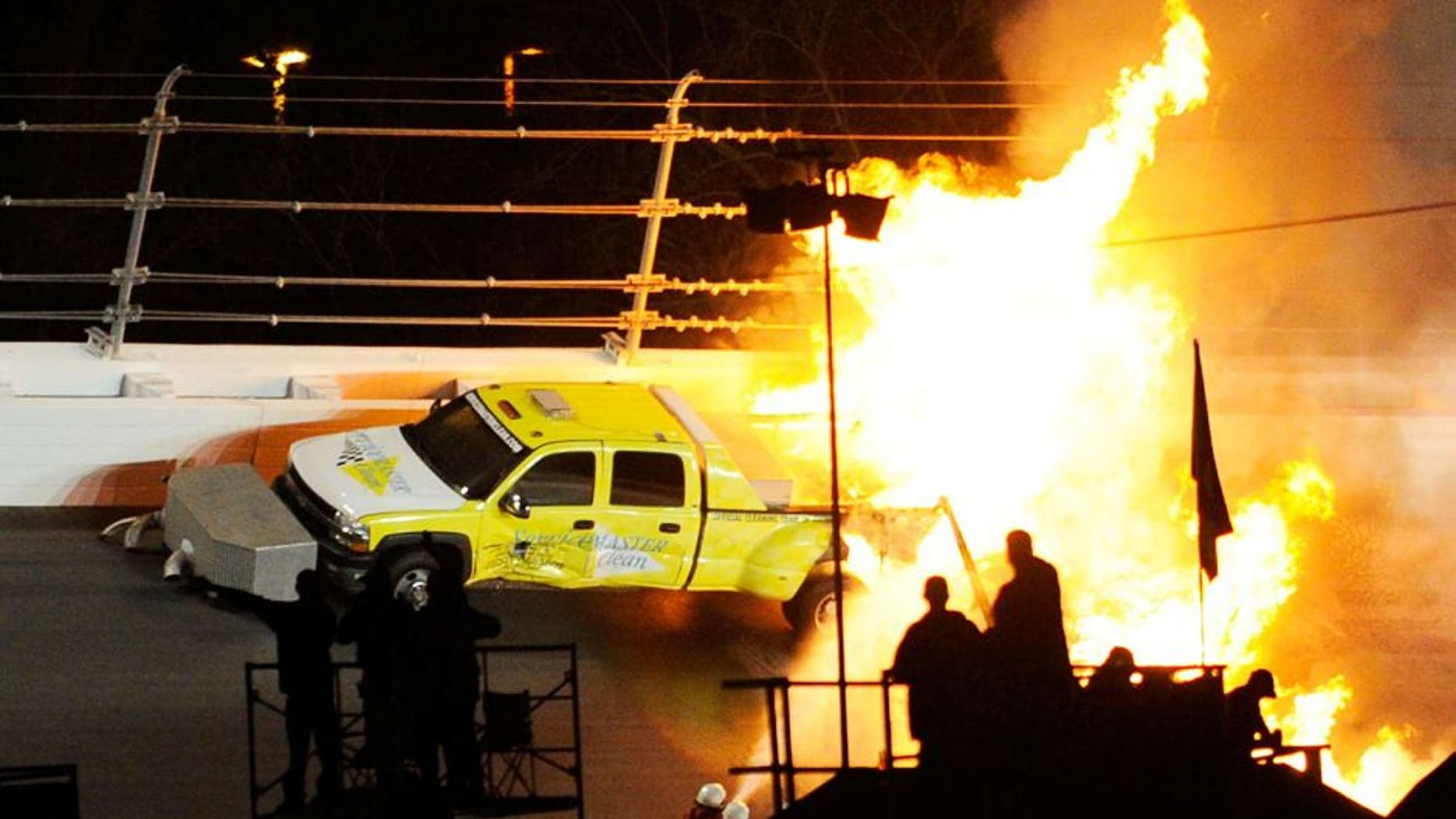 DAYTONA BEACH, FL - FEBRUARY 27: Safety workers try to extinguish a fire from a jet dryer after being hit by Juan Pablo Montoya, driver of the #42 Target Chevrolet, under caution during the NASCAR Sprint Cup Series Daytona 500 at Daytona International Speedway on February 27, 2012 in Daytona Beach, Florida. (Photo by John Harrelson/Getty Images for NASCAR)