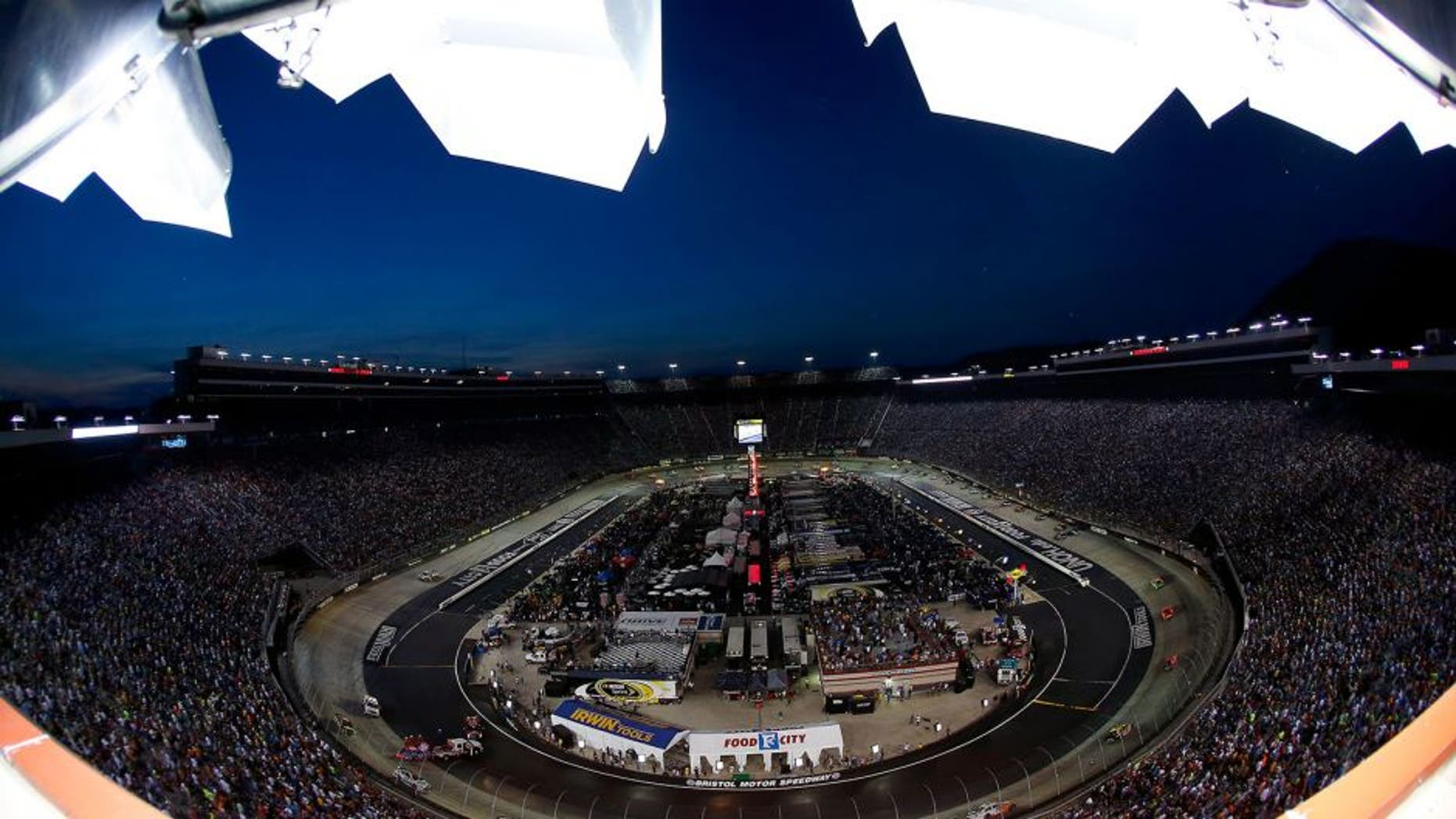BRISTOL, TN - AUGUST 23: Cars race during the NASCAR Sprint Cup Series Irwin Tools Night Race at Bristol Motor Speedway on August 23, 2014 in Bristol, Tennessee. (Photo by Tom Pennington/NASCAR via Getty Images)