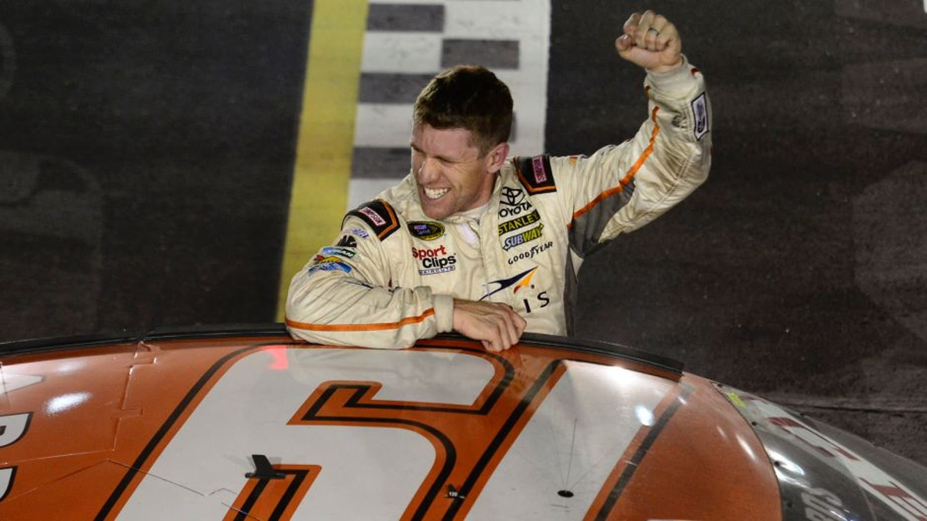 DARLINGTON, SC - SEPTEMBER 06: Carl Edwards, driver of the #19 ARRIS Toyota, salutes the crowd after winning the NASCAR Sprint Cup Series Bojangles' Southern 500 at Darlington Raceway on September 6, 2015 in Darlington, South Carolina. (Photo by Robert Laberge/NASCAR via Getty Images)