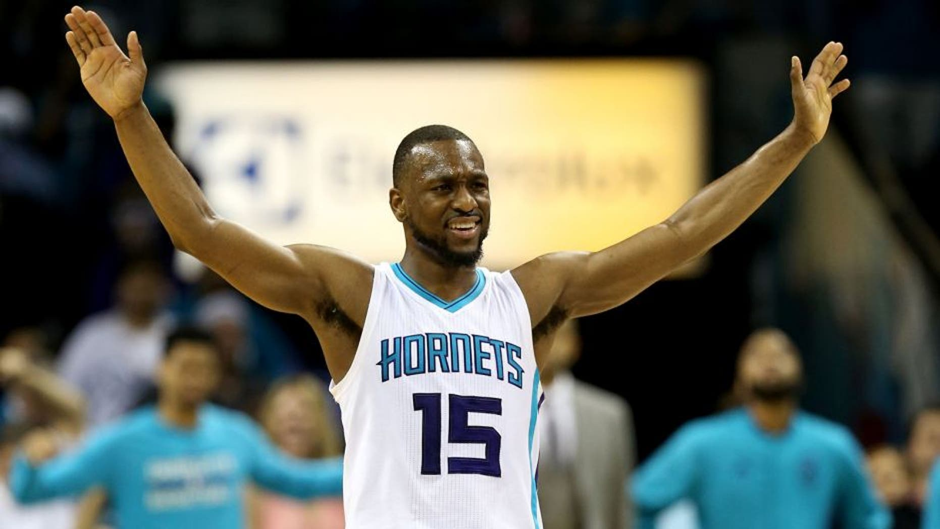 CHARLOTTE, NC - APRIL 25: Kemba Walker #15 of the Charlotte Hornets reacts to the crowd against the Miami Heat during game four of the Eastern Conference Quarterfinals of the 2016 NBA Playoffs at Time Warner Cable Arena on April 25, 2016 in Charlotte, North Carolina. NOTE TO USER: User expressly acknowledges and agrees that, by downloading and or using this photograph, User is consenting to the terms and conditions of the Getty Images License Agreement. (Photo by Streeter Lecka/Getty Images)