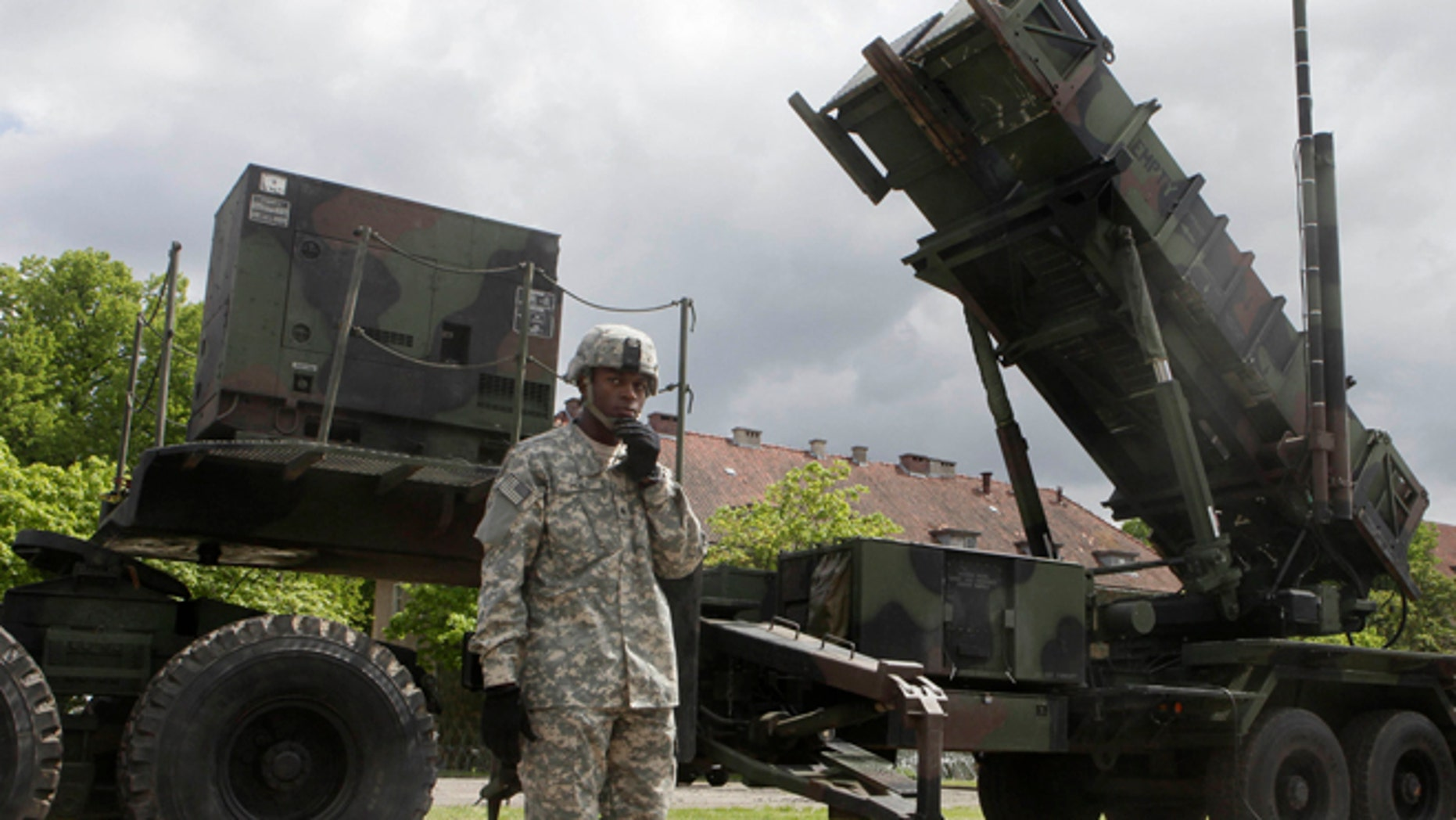 May 26, 2010: A U.S. soldier stands next to a Patriot surface-to-air missile battery at an army base in Morag, Poland.