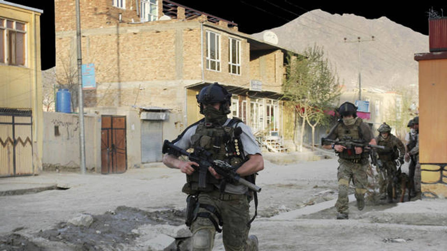 April 15, 2012: NATO soldiers run during a gun battle in Kabul, Afghanistan.