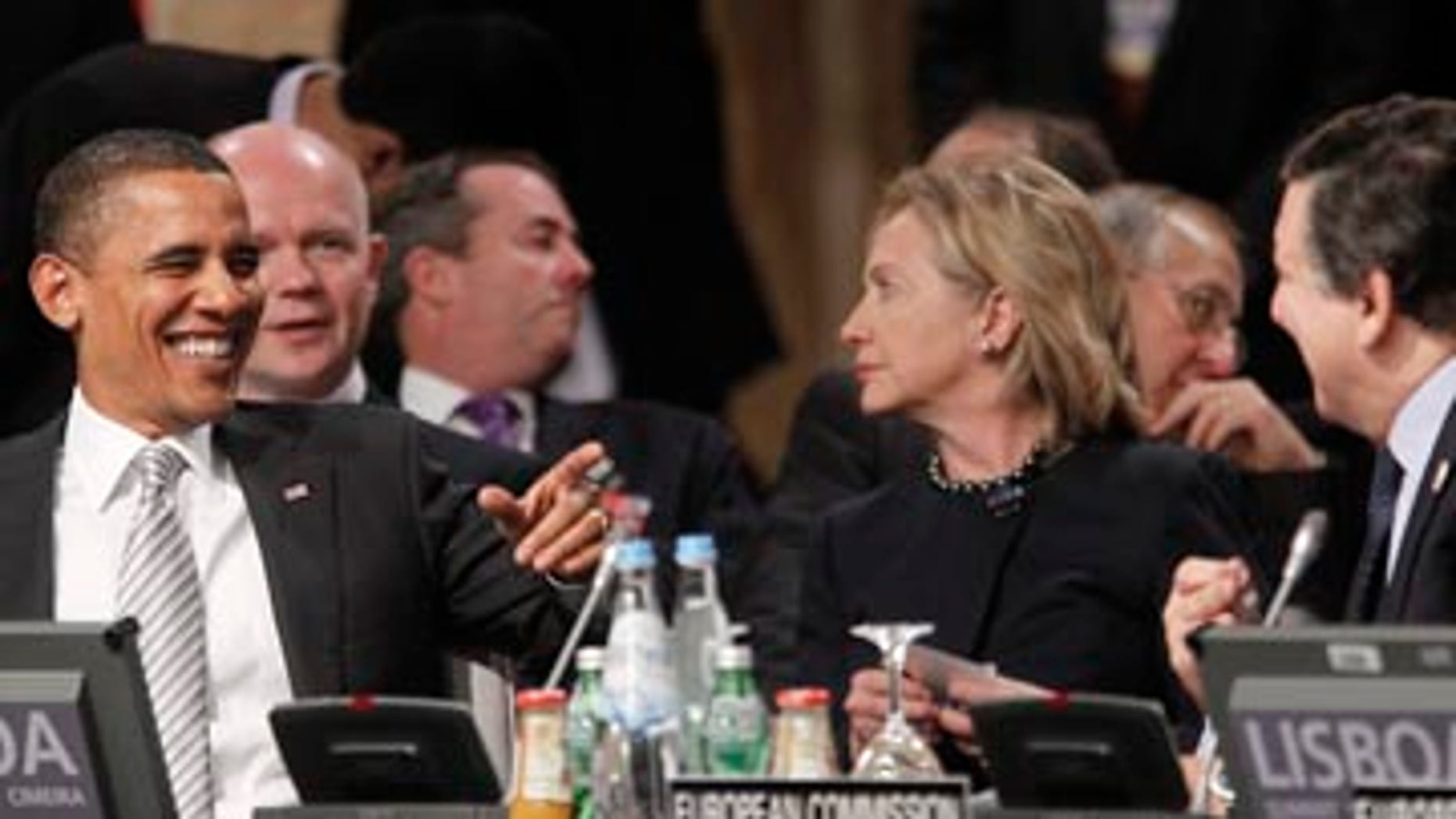 Saturday: Secretary of State Hillary Clinton and President Obama at the Afghanistan Opening Session at the NATO Summit in Lisbon, Portugal.