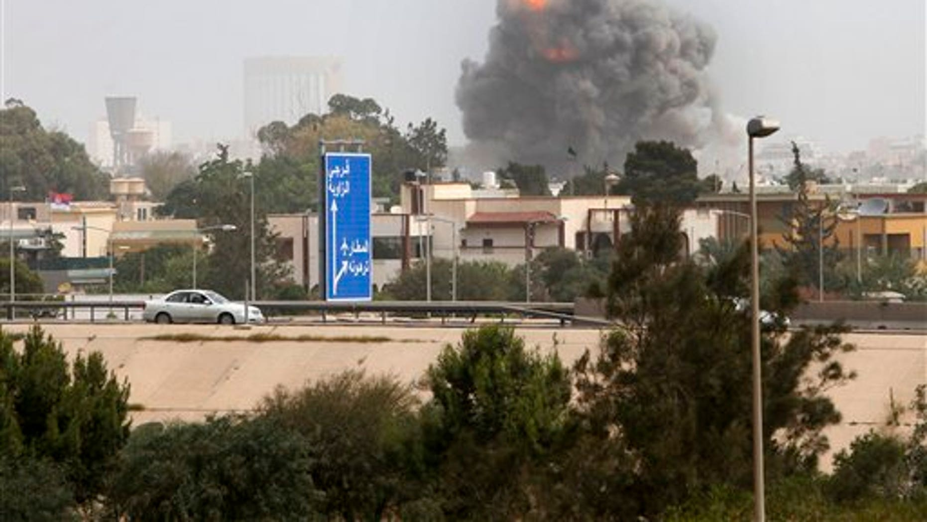 June 7: A smoke and dust cloud from an explosion rises into the sky after a NATO airstrike in Tripoli, Libya. Muammar al-Qaddafi vowed to fight to the death in a defiant speech Tuesday after NATO military craft unleashed a ferocious series of daytime airstrikes on Tripoli. (AP)