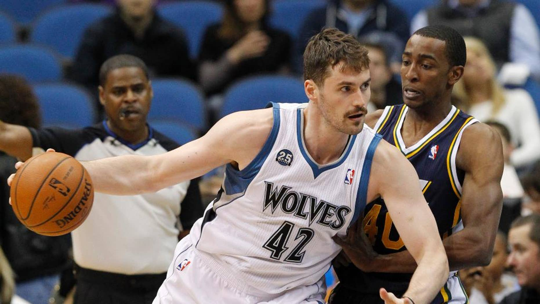FILE - In this Wednesday, April 16, 2014, file photo, Minnesota Timberwolves forward Kevin Love (42) drives against Utah Jazz forward Jeremy Evans during the first quarter of an NBA basketball game in Minneapolis. Three-time NBA All-Star Love could hear his name called on draft night _ again. The Minnesota Timberwolves big man headlines a list of veteran NBA players who could have a major influence on how the draft unfolds, on Thursday, June 26, 2014. (AP Photo/Ann Heisenfelt, File)