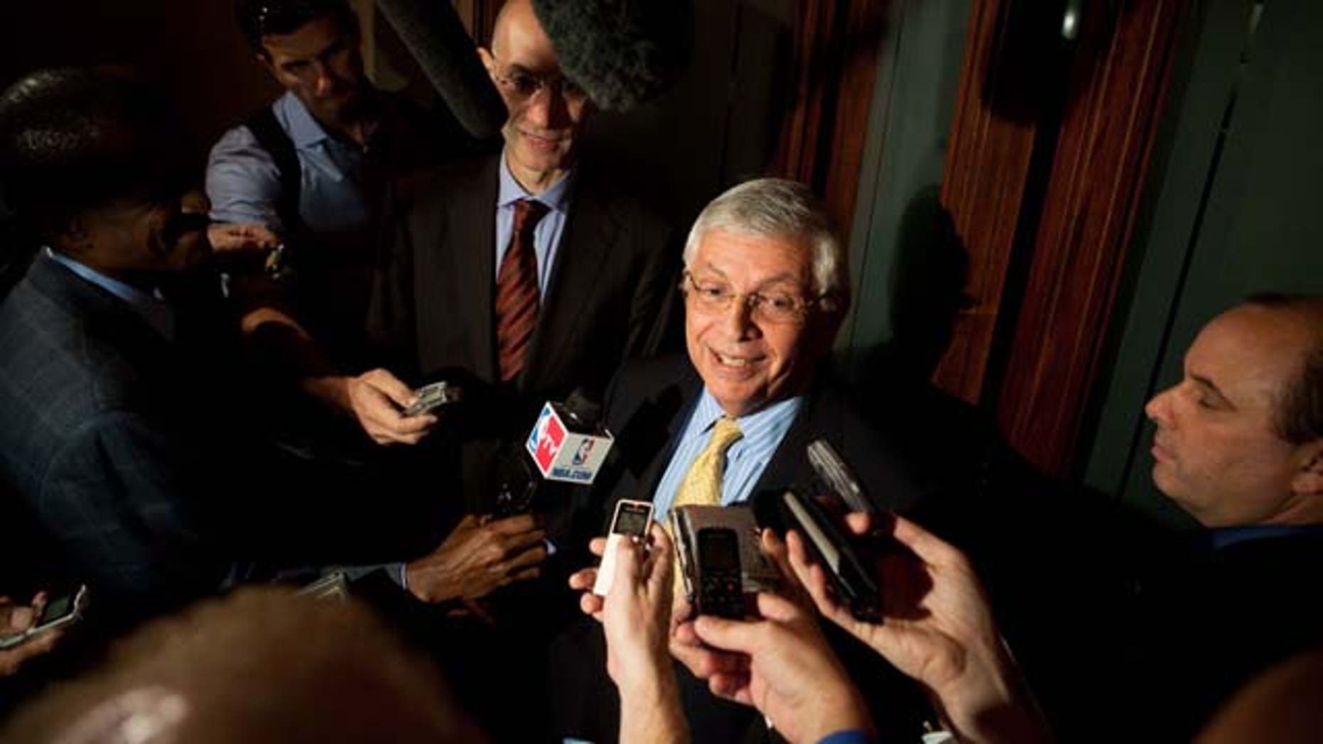 NBA Commissioner David Stern, center, speaks to reporters after a meeting between the NBA Players Association and owners to discuss a new labor deal and possibly avert a lockout, Friday, Sept. 30, 2011, in New York. (AP Photo/John Minchillo)