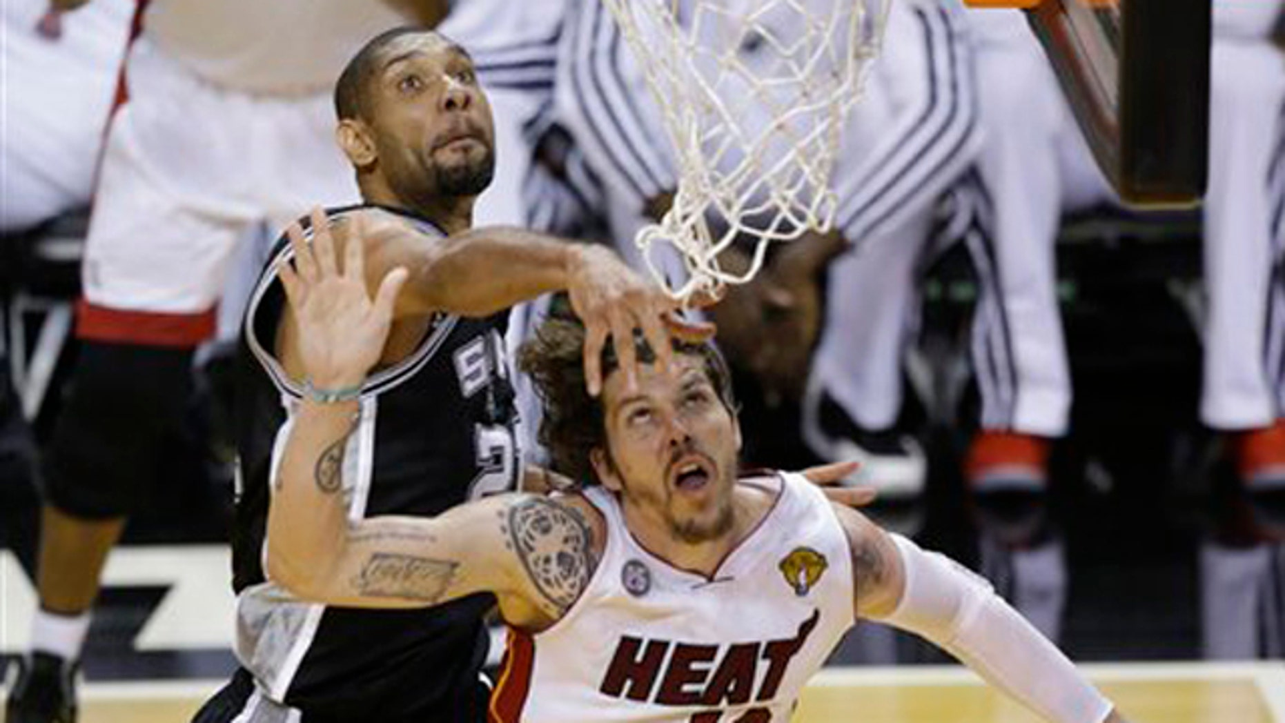 June 18, 2013: San Antonio Spurs power forward Tim Duncan (21) blocks the shot of Miami Heat shooting guard Mike Miller (13) during the second half of Game 6 of the NBA Finals basketball game.