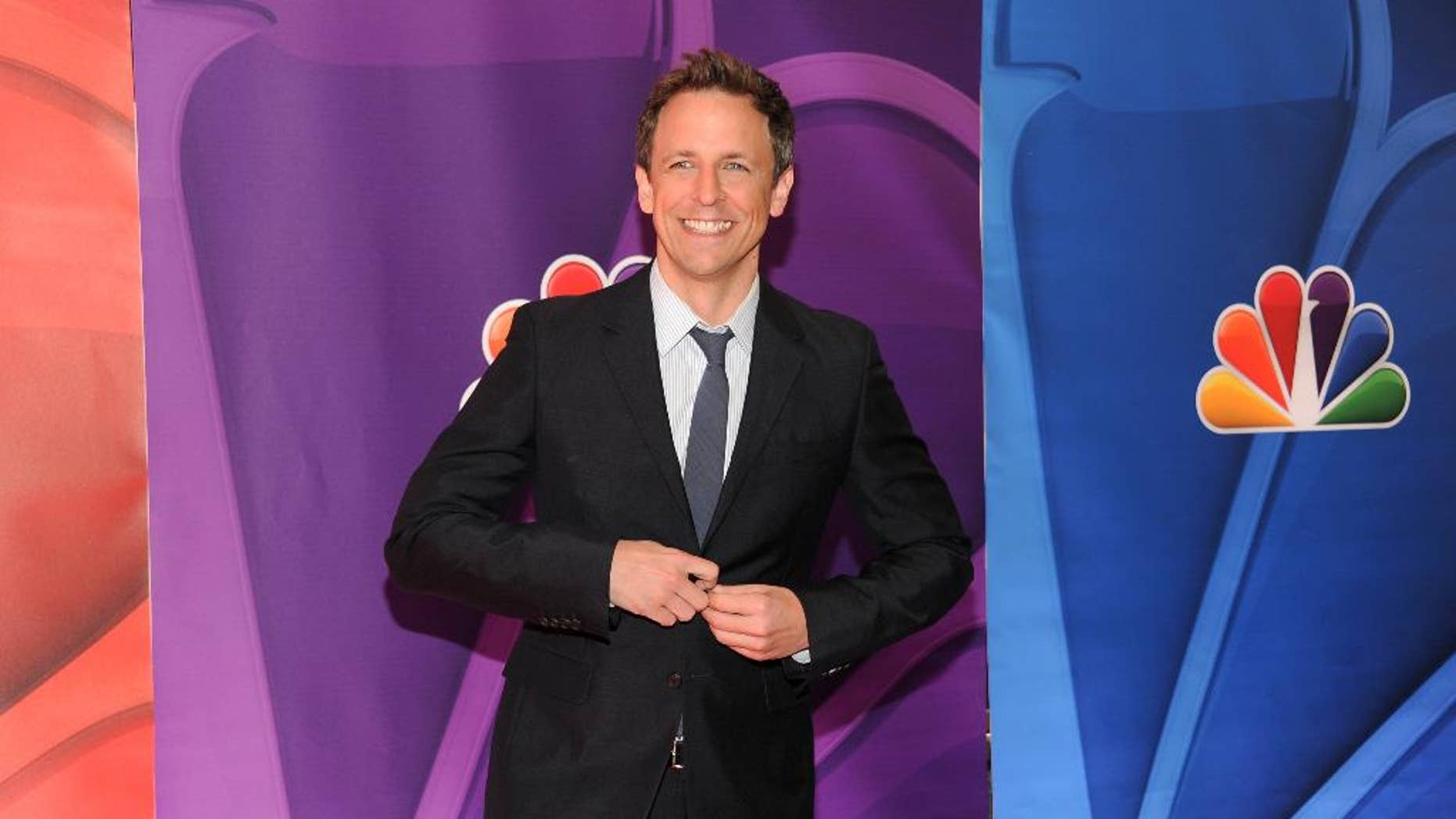 """FILE - Seth Meyers attends the NBC Network 2013 Upfront at Radio City Music Hall, in this May 13, 2013 file photo taken in New York. NBC, home to Meyers in his long stint on """"Saturday Night Live"""" and his new late-night talk show, announced late Thursday April 24, 2014 that he'll host the 66th edition of the Emmys set to air on the network August 25. (Photo by Evan Agostini/Invision/AP, File)"""