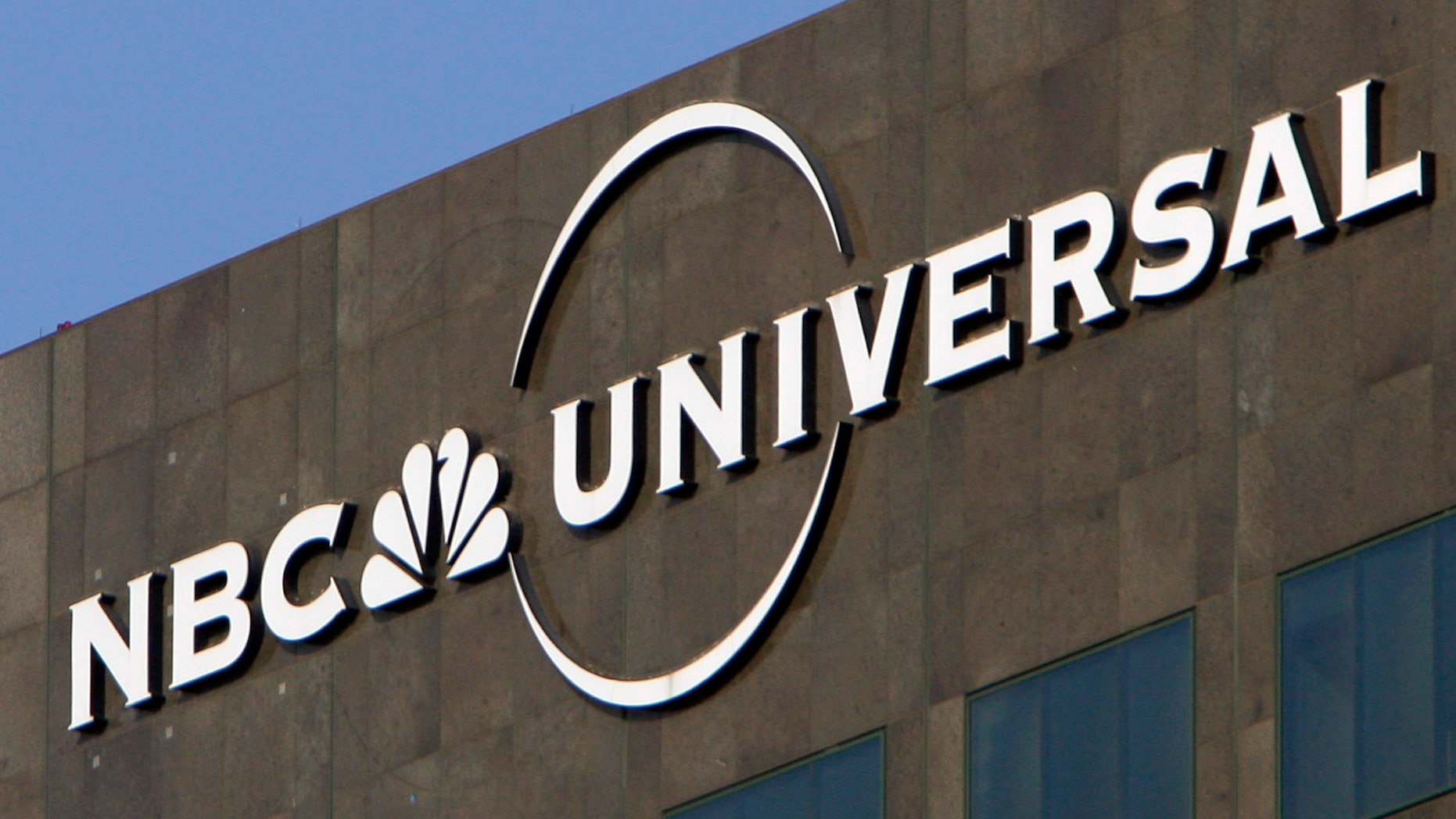 Dec. 3, 2009. The NBC Universal logo hangs on a building in Los Angeles.