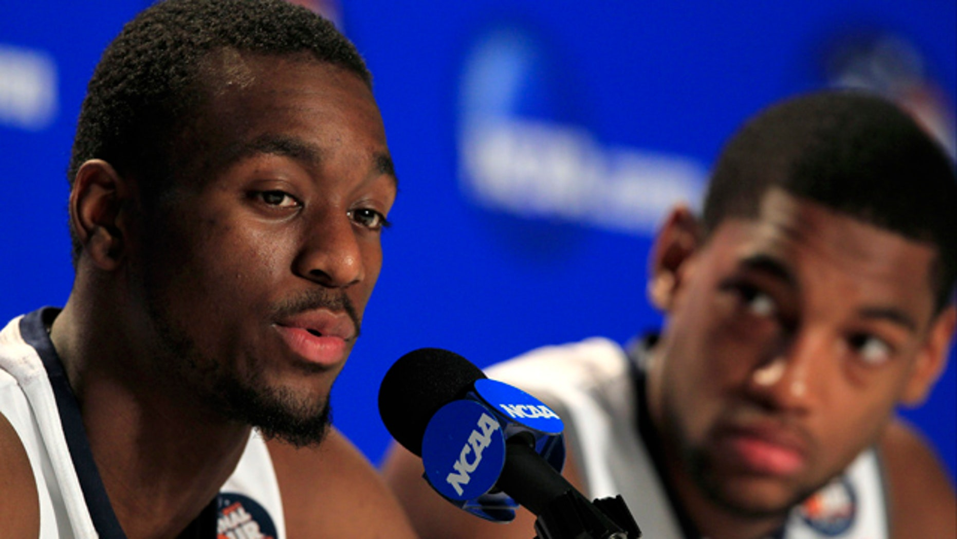 April 3, 2011: Connecticut's Kemba Walker, left, speaks during a news conference as teammate Roscoe Smith looks on before a practice session for the men's NCAA Final Four college basketball championship game in Houston.