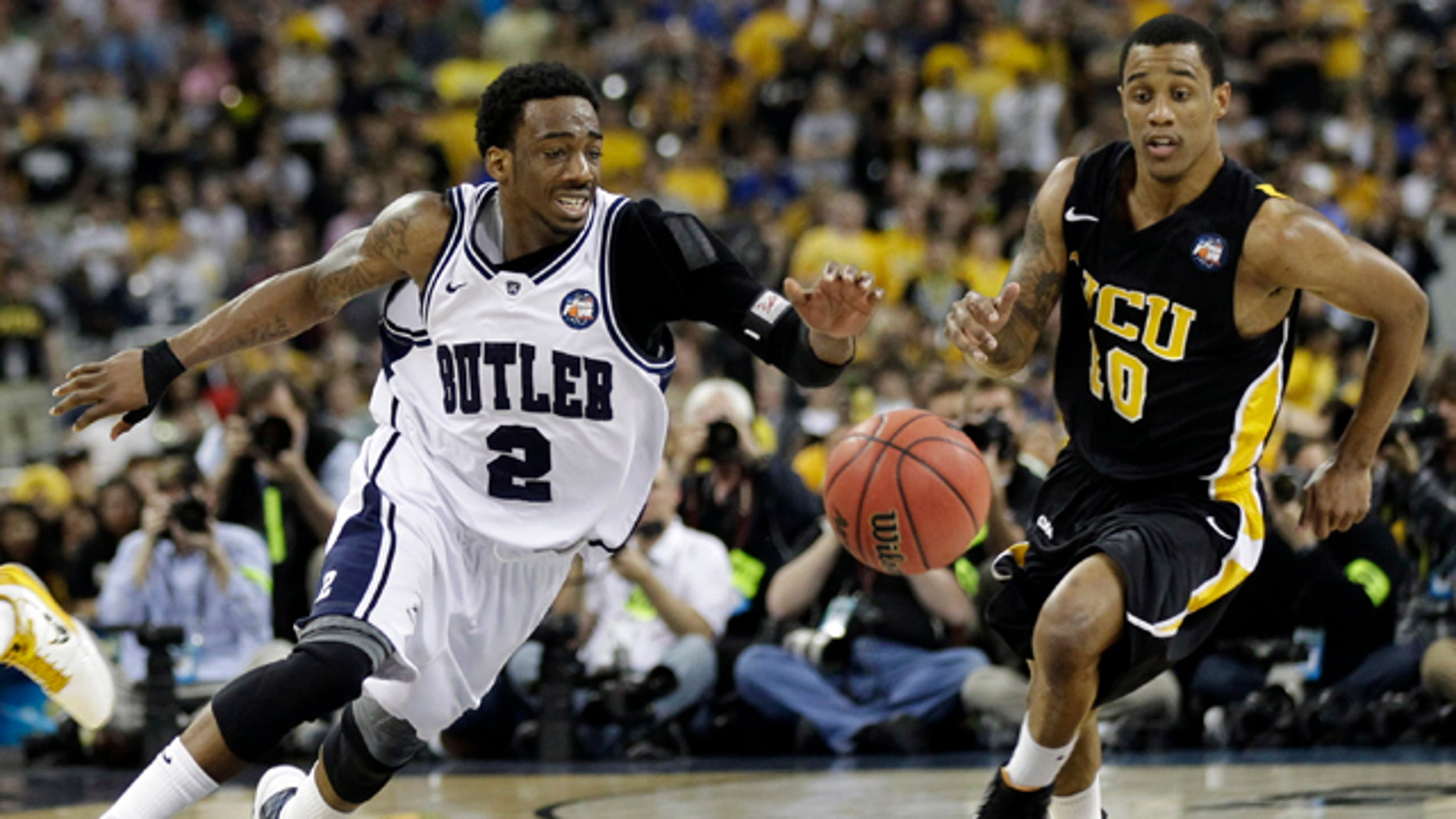 April 2: Butler's Shawn Vanzant and Virginia Commonwealth's Darius Theus chase a loose ball during the second half of a men's NCAA Final Four semifinal college basketball game