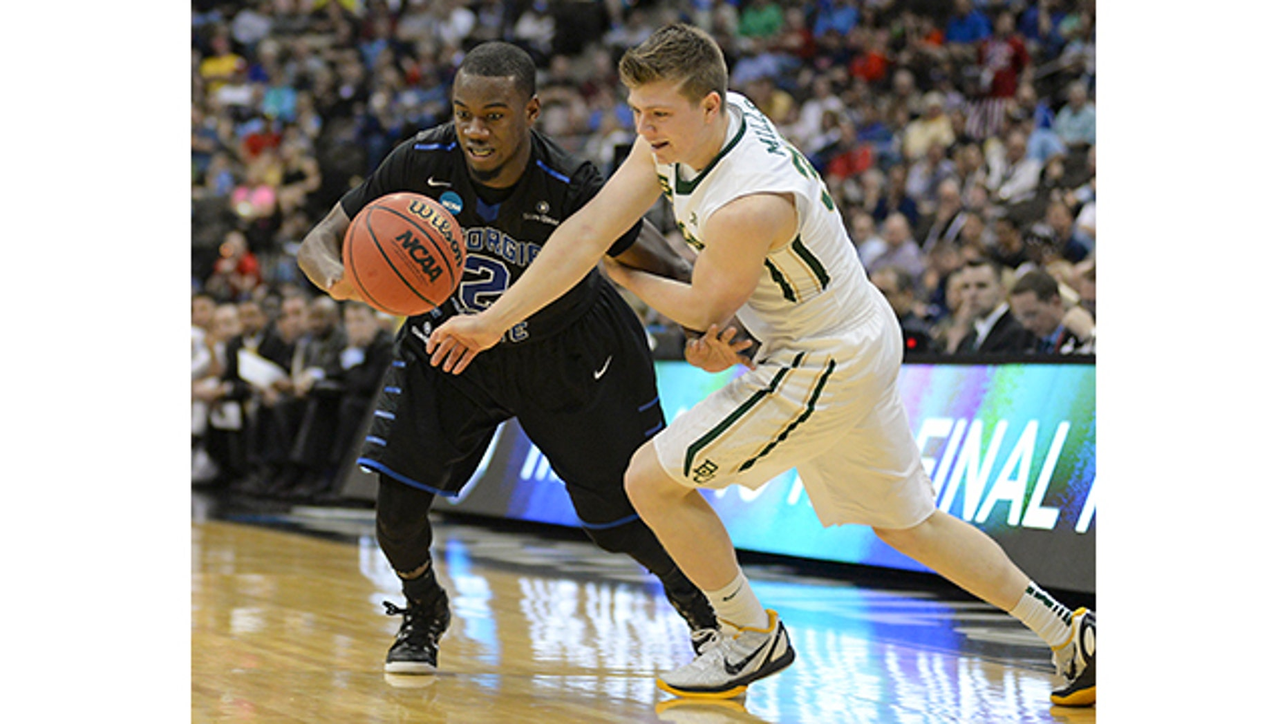 March 19, 2015: Georgia State guard Ryann Green, left, and Baylor guard Austin Mills, right, battle for the ball during the second half in the second round of the NCAA college basketball tournament in Jacksonville, Fla. (AP Photo/Rick Wilson)